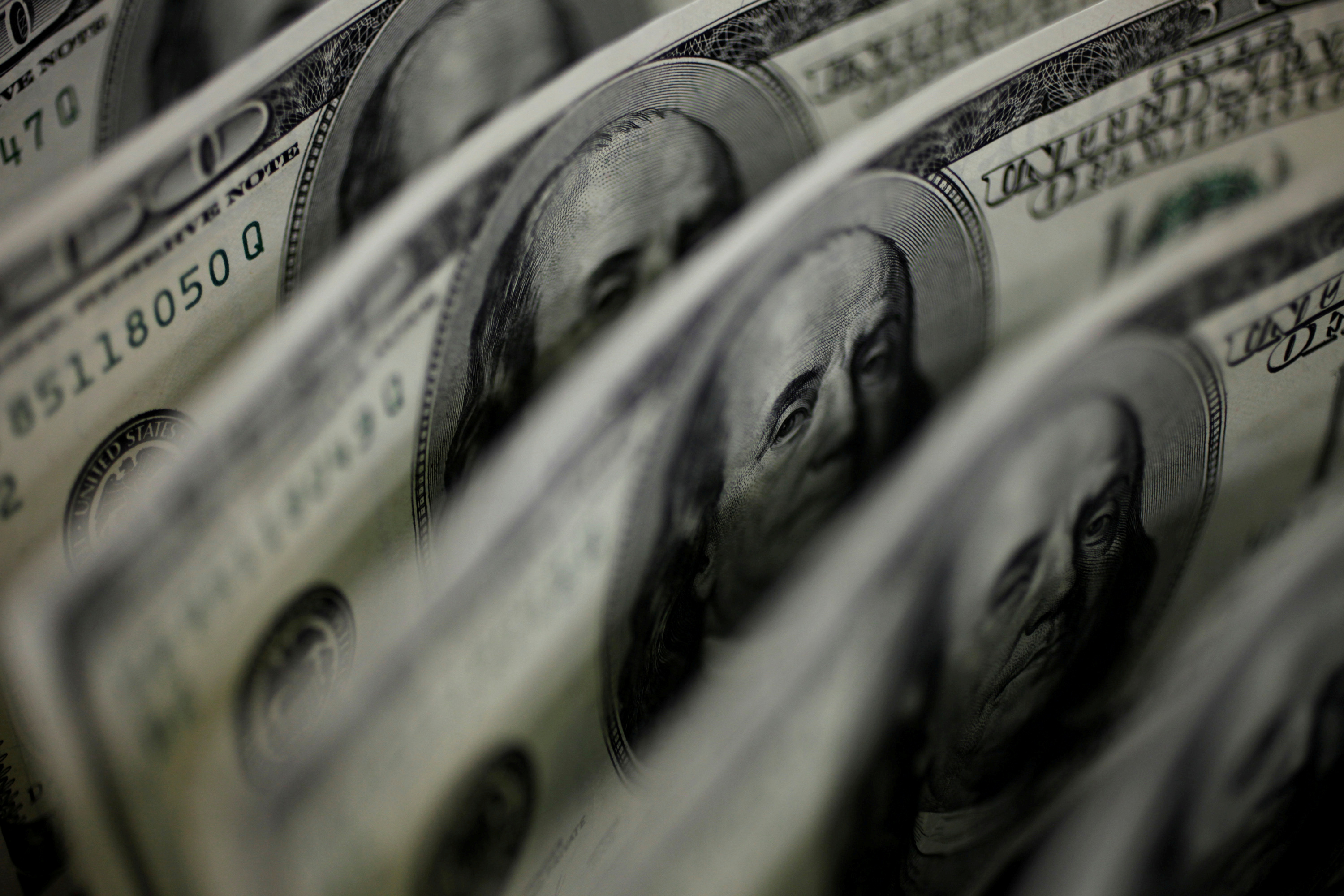 A picture illustration shows U.S. 100 dollar bank notes taken in Tokyo August 2, 2011. REUTERS/Yuriko Nakao