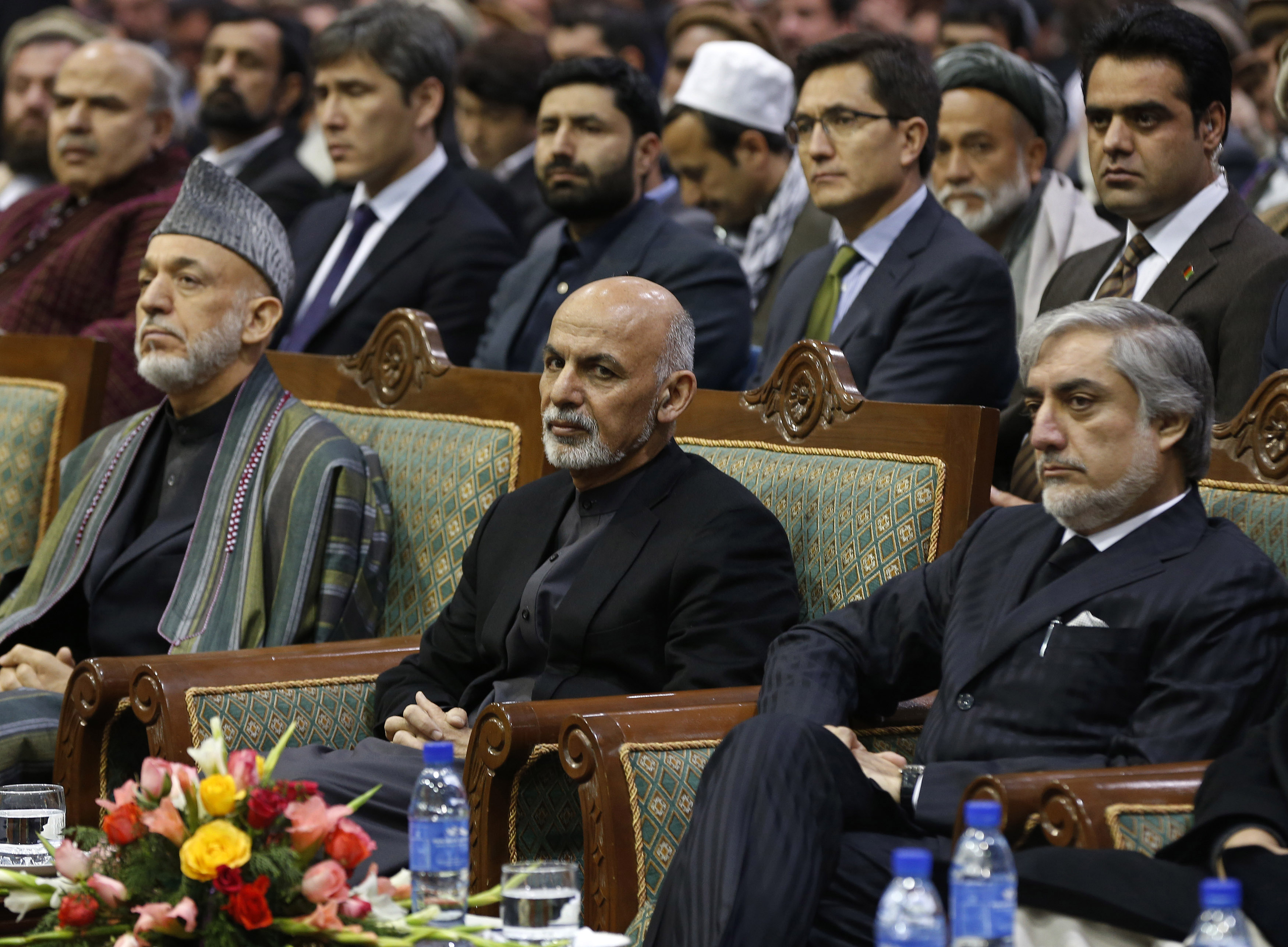 Afghan President Ashraf Ghani (C) attends a commemoration of the first death anniversary of former vice president Mohammad Qasim Fahim, also known as the Marshal of Afghanistan, in Kabul March 9, 2015. On the left is former President Hamid Karzai and Chief Executive Abdullah Abdullah is seen on the right. REUTERS/Omar Sobhani (AFGHANISTAN - Tags: ANNIVERSARY POLITICS)
