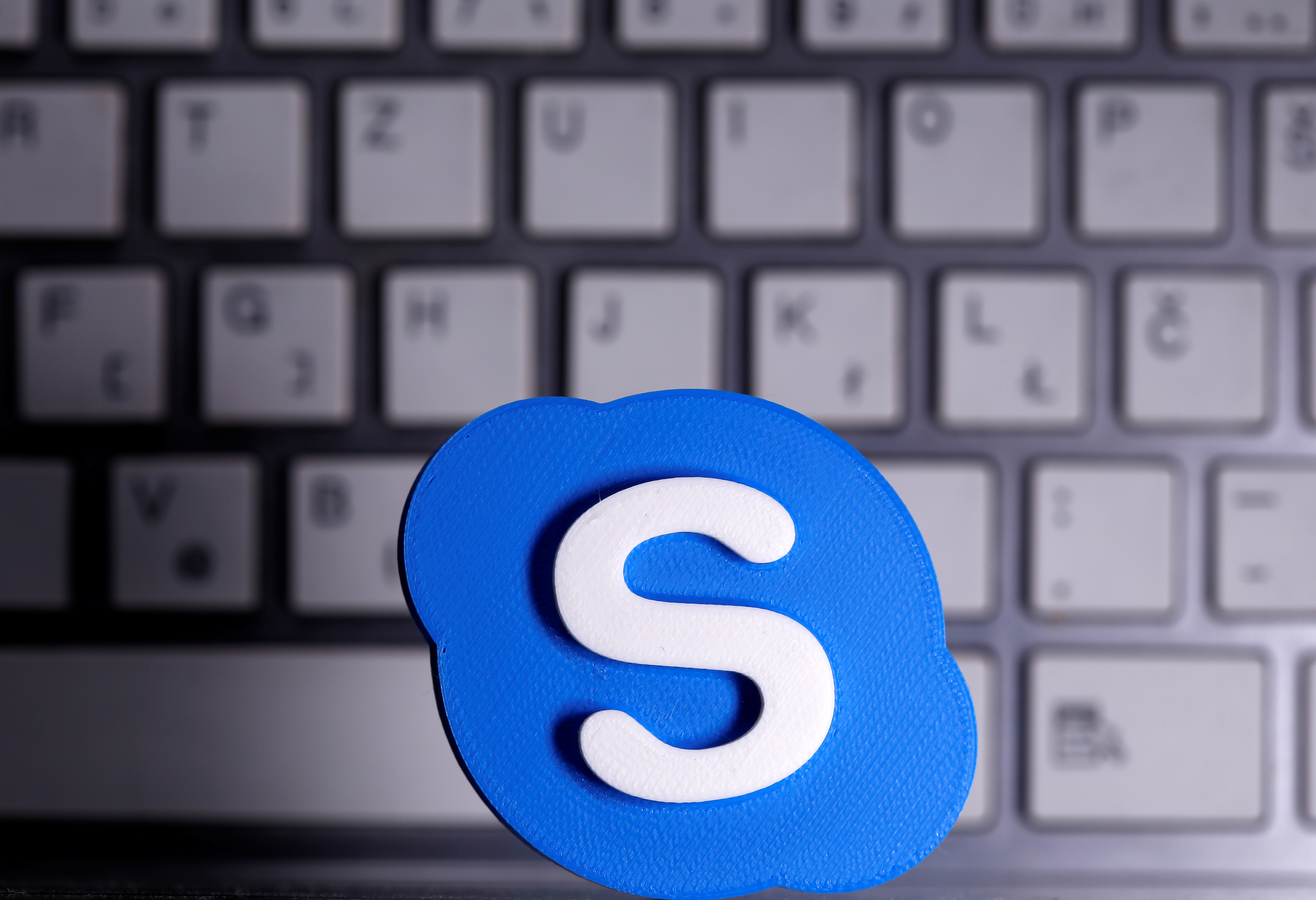 A 3D printed Skype logo is placed in front of a keyboard in this illustration taken April 12, 2020. REUTERS/Dado Ruvic/Illustration