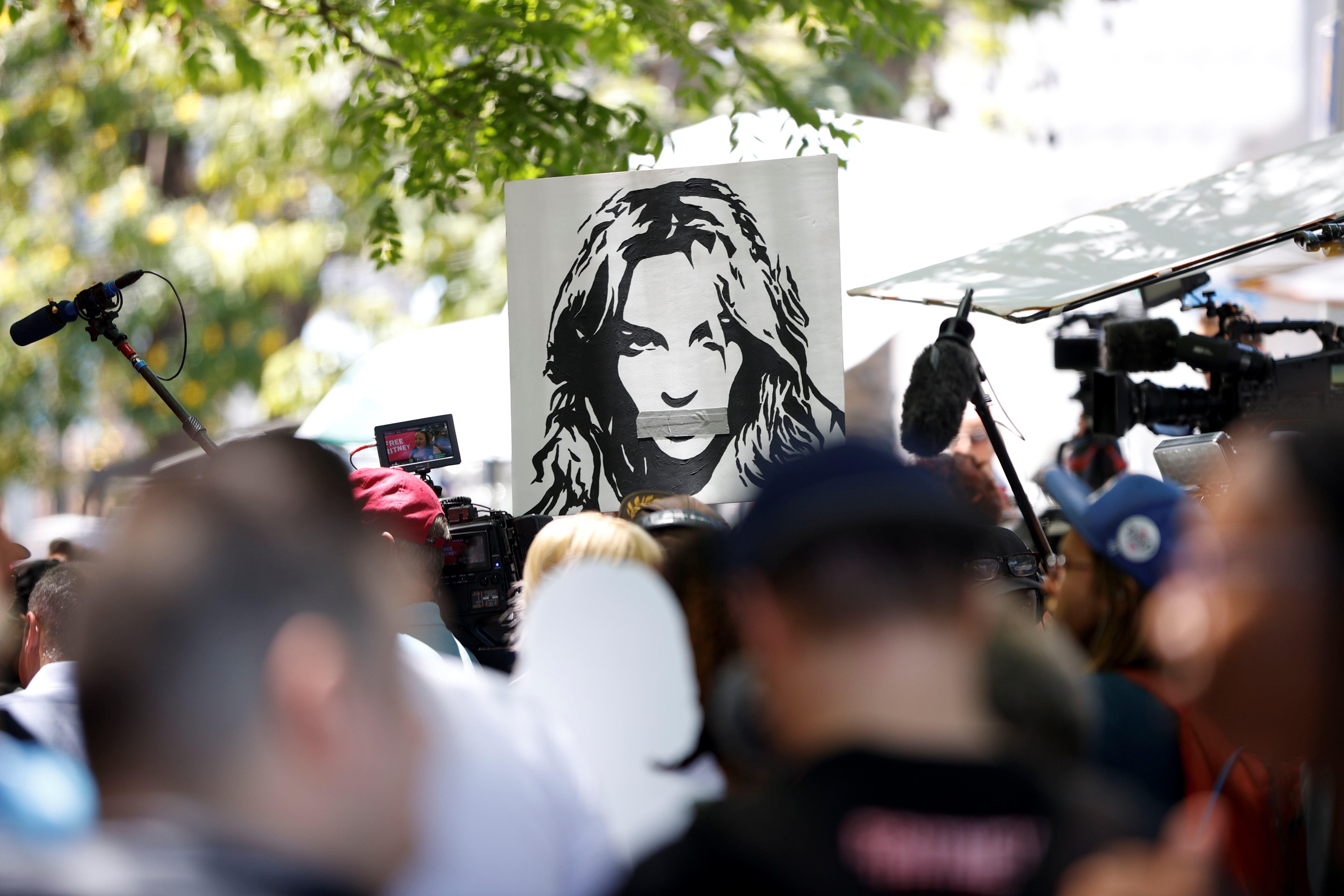 People protest in support of pop star Britney Spears on the day of a conservatorship case hearing at Stanley Mosk Courthouse in Los Angeles, California, U.S. June 23, 2021. REUTERS/Mario Anzuoni