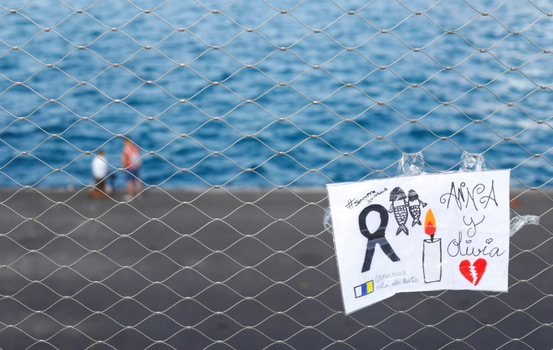 A sign placed on a fence in memory of the missing girls in the Canary Islands is seen in Santa Cruz de Tenerife, Spain June 11, 2021. REUTERS/Borja Suarez