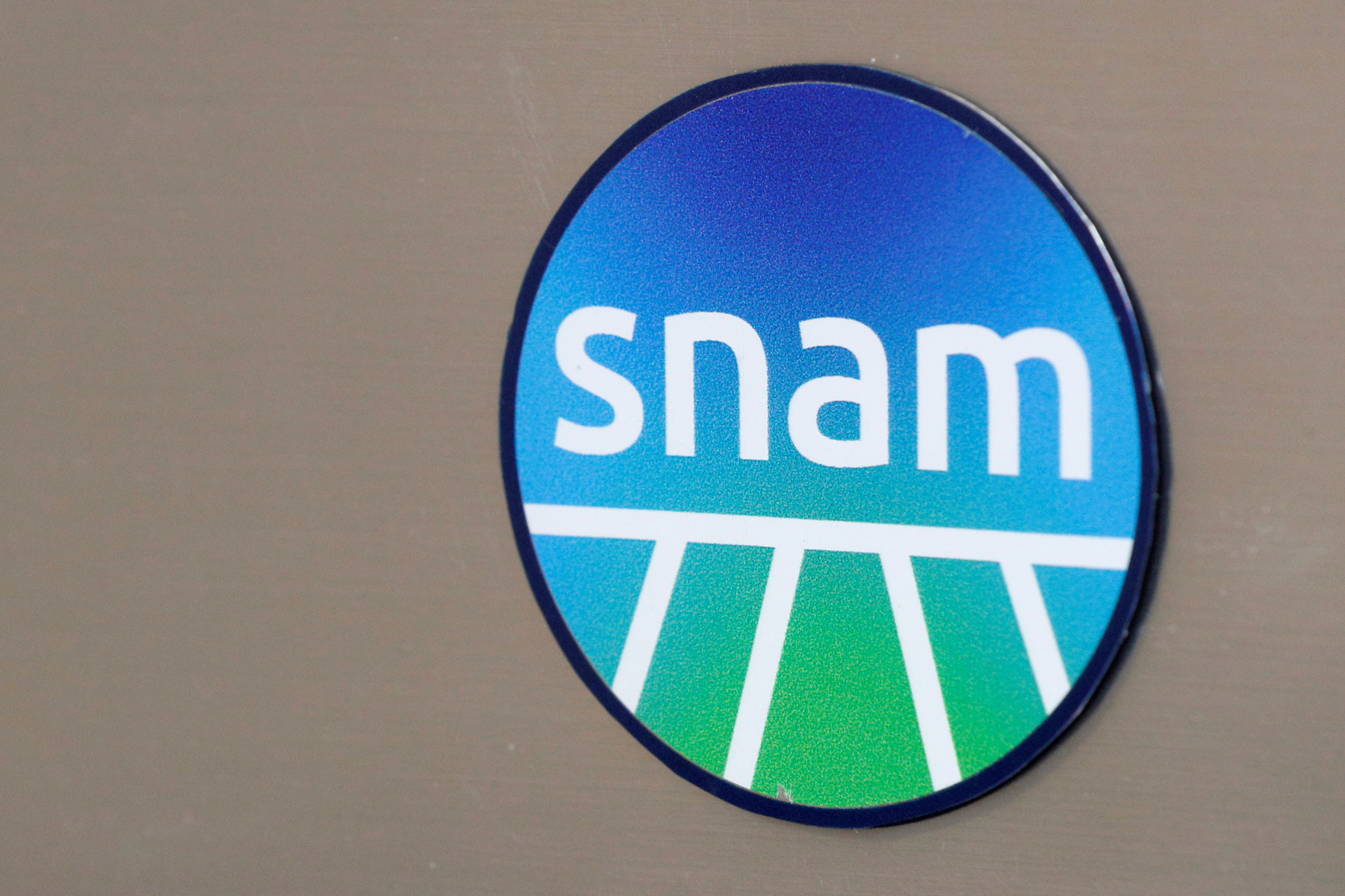 Italian gas group Snam's logo is seen outside its office in Rome, Italy, June 4, 2020. REUTERS/Guglielmo Mangiapane/File Photo