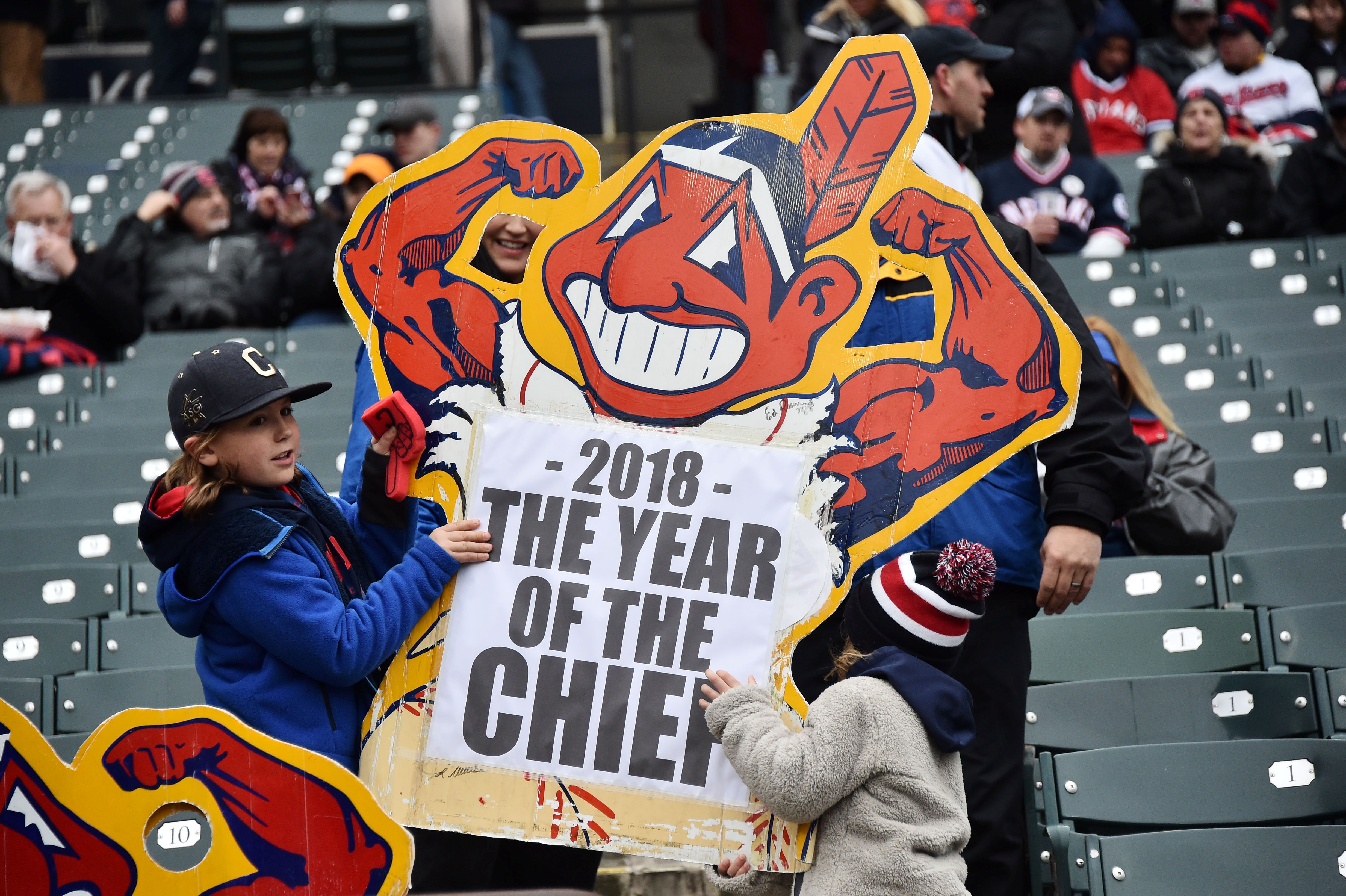 Apr 6, 2018; Cleveland, OH, USA; Fans hold a sign referencing the Cleveland Indians mascot Chief Wahoo logo before a game between the Cleveland Indians and the Kansas City Royals at Progressive Field. / Ken Blaze-USA TODAY Sports/File Photo