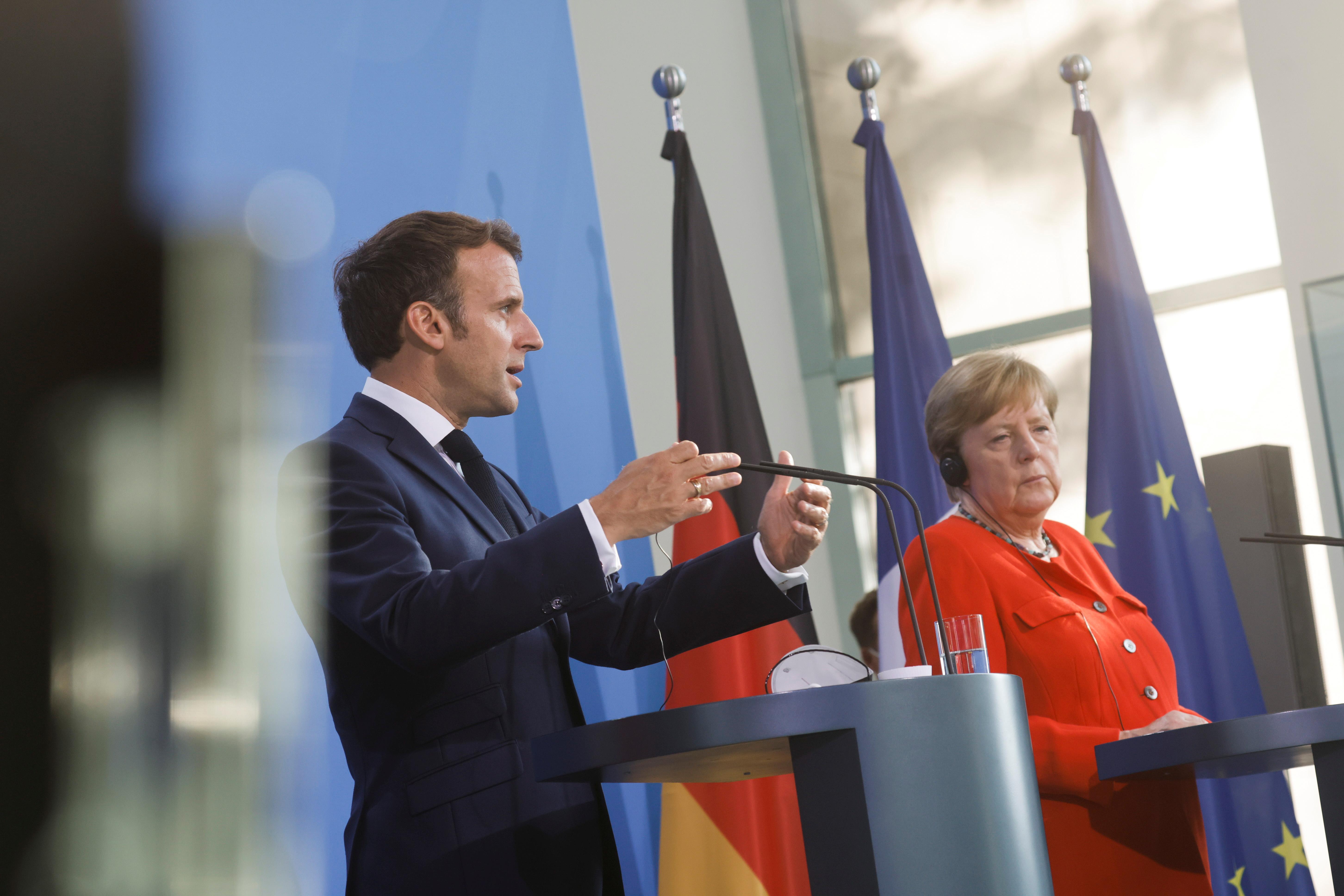 French President Emmanuel Macron speaks as he and German Chancellor Angela Merkel give a news statement in Berlin, Germany, June 18, 2021. REUTERS/Axel Schmidt/Pool
