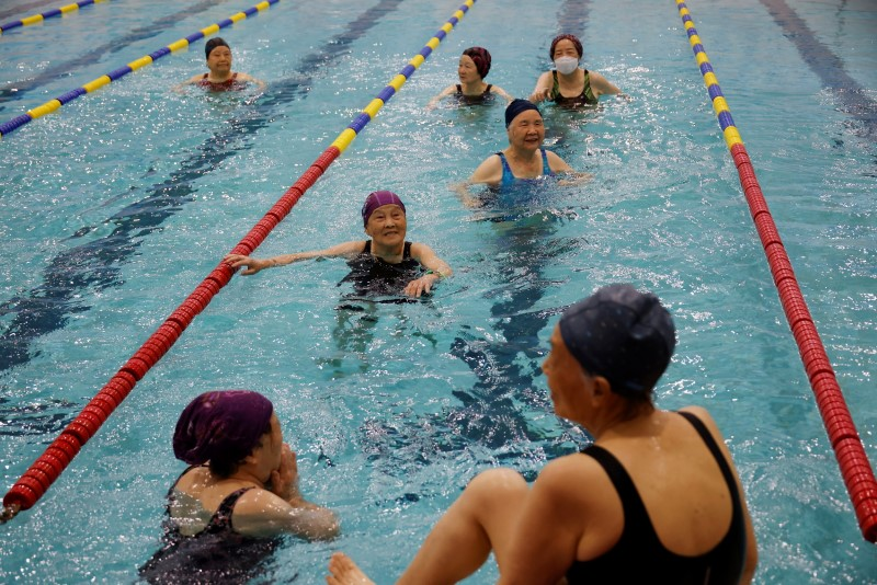 Elderly women, who have been fully vaccinated against the coronavirus disease (COVID-19), enjoy aquarobics at a pool in Seoul, South Korea, June 17, 2021.  REUTERS/Kim Hong-Ji