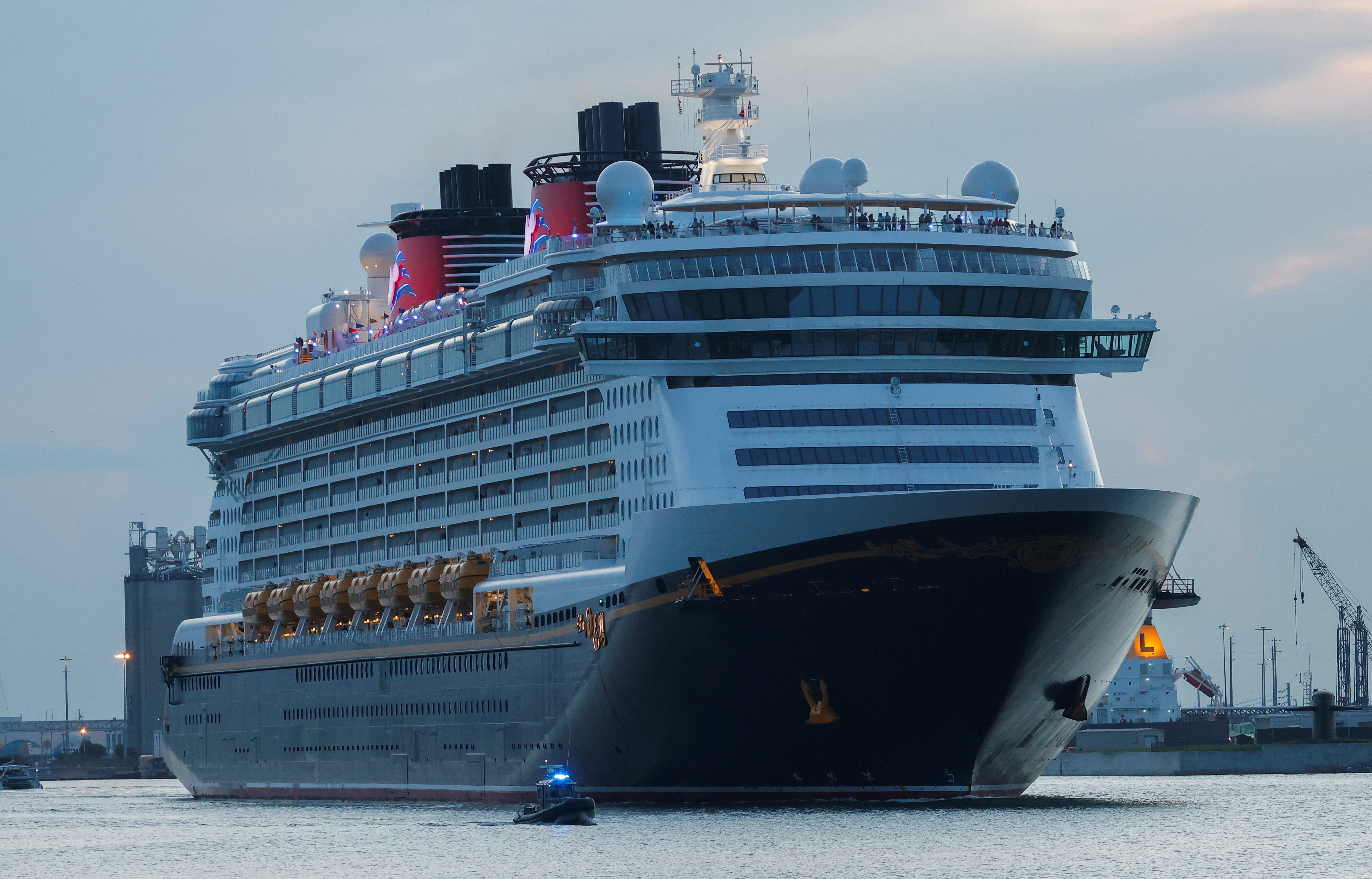 Disney Dream, a Disney Cruise Lines' ship, sails to the Bahamas on the first Disney cruise for paying customers since they were stopped during the coronavirus disease (COVID-19) pandemic, from Port Canaveral in Florida, U.S., August 9, 2021. REUTERS/Joe Skipper