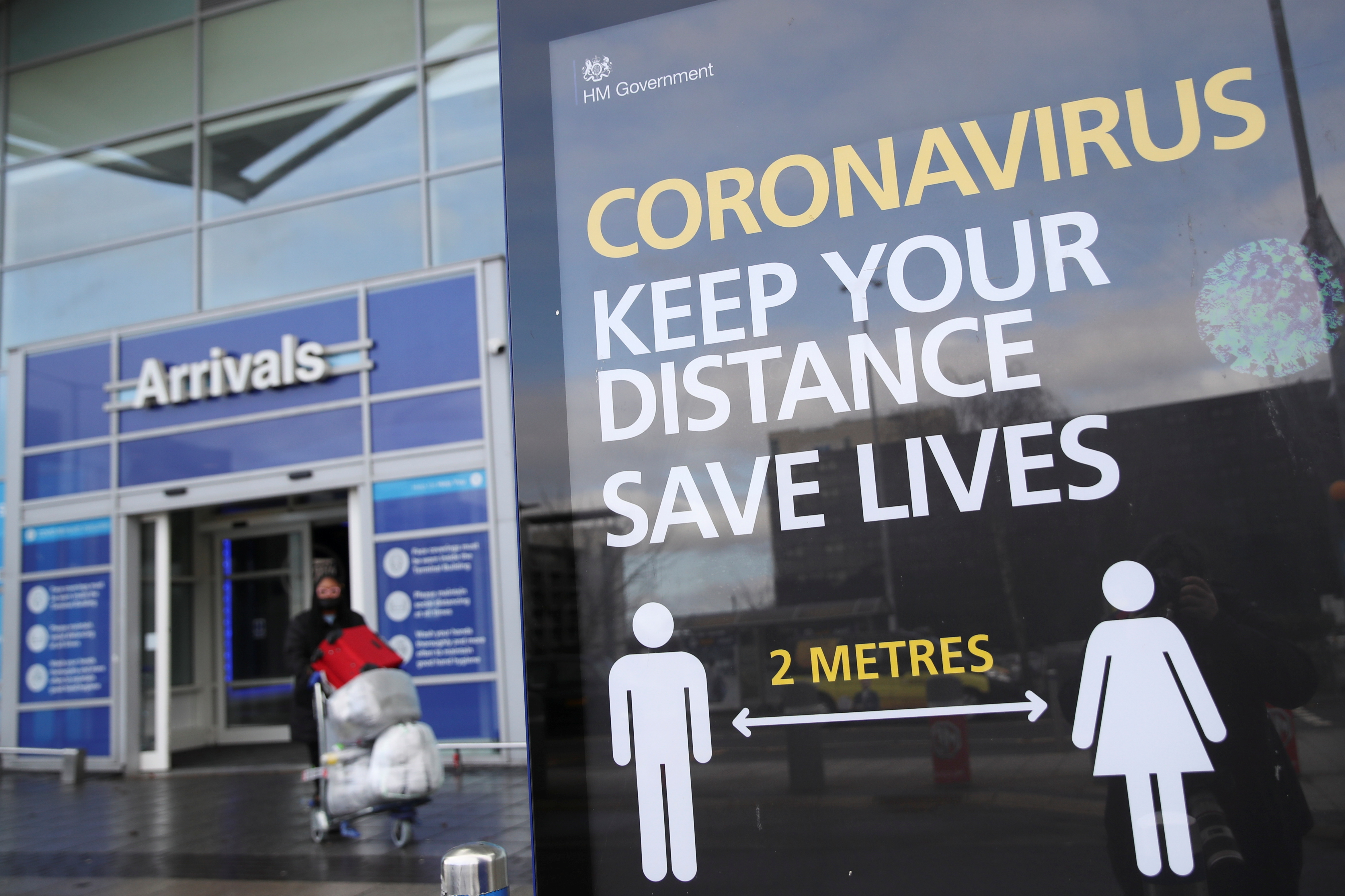 An information board is seen at Birmingham Airport, as Britain introduces hotel quarantine programme for arrivals from a