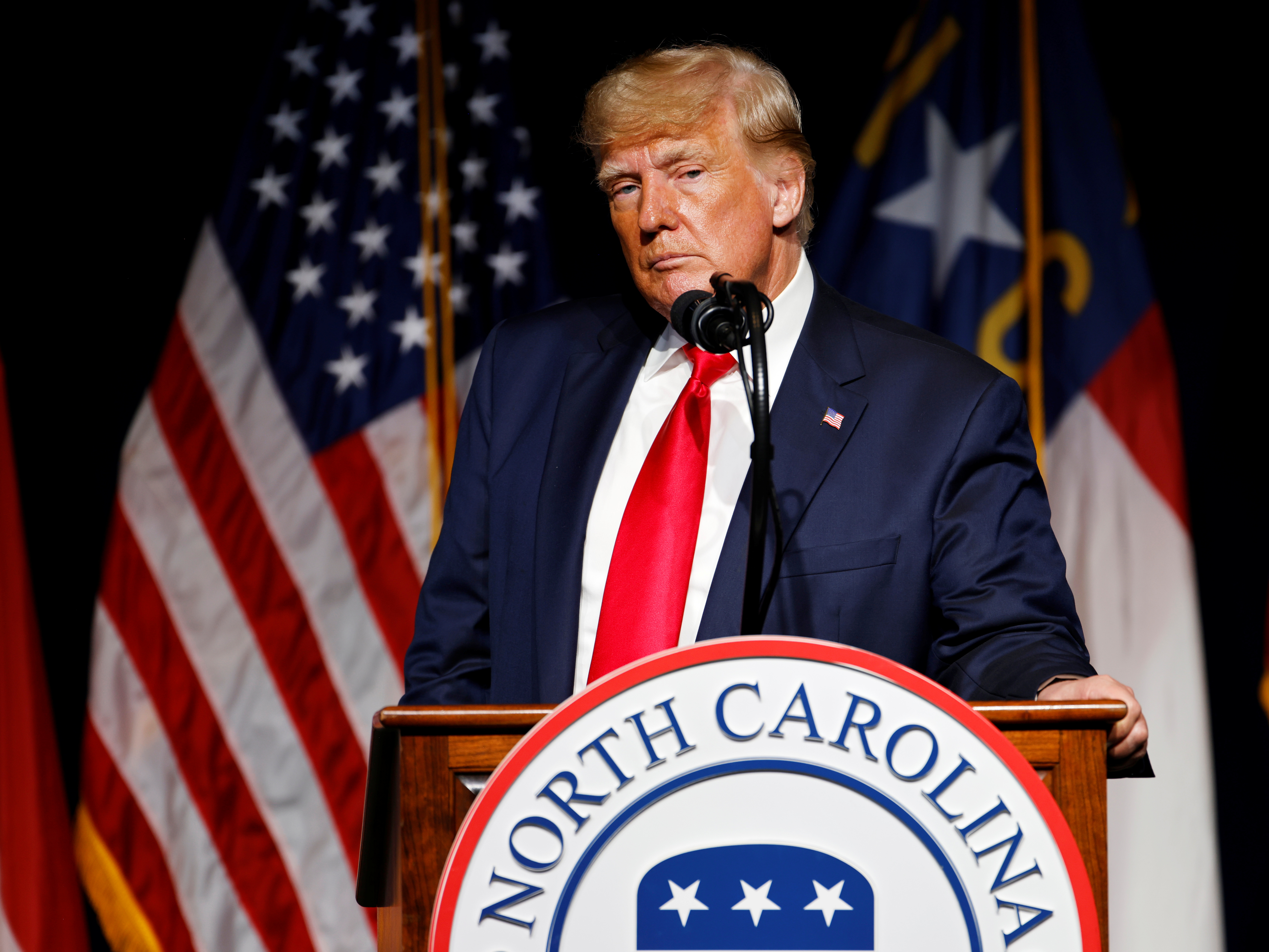 Former U.S. President Donald Trump pauses while speaking at the North Carolina GOP convention dinner in Greenville, North Carolina, U.S. June 5, 2021.  REUTERS/Jonathan Drake
