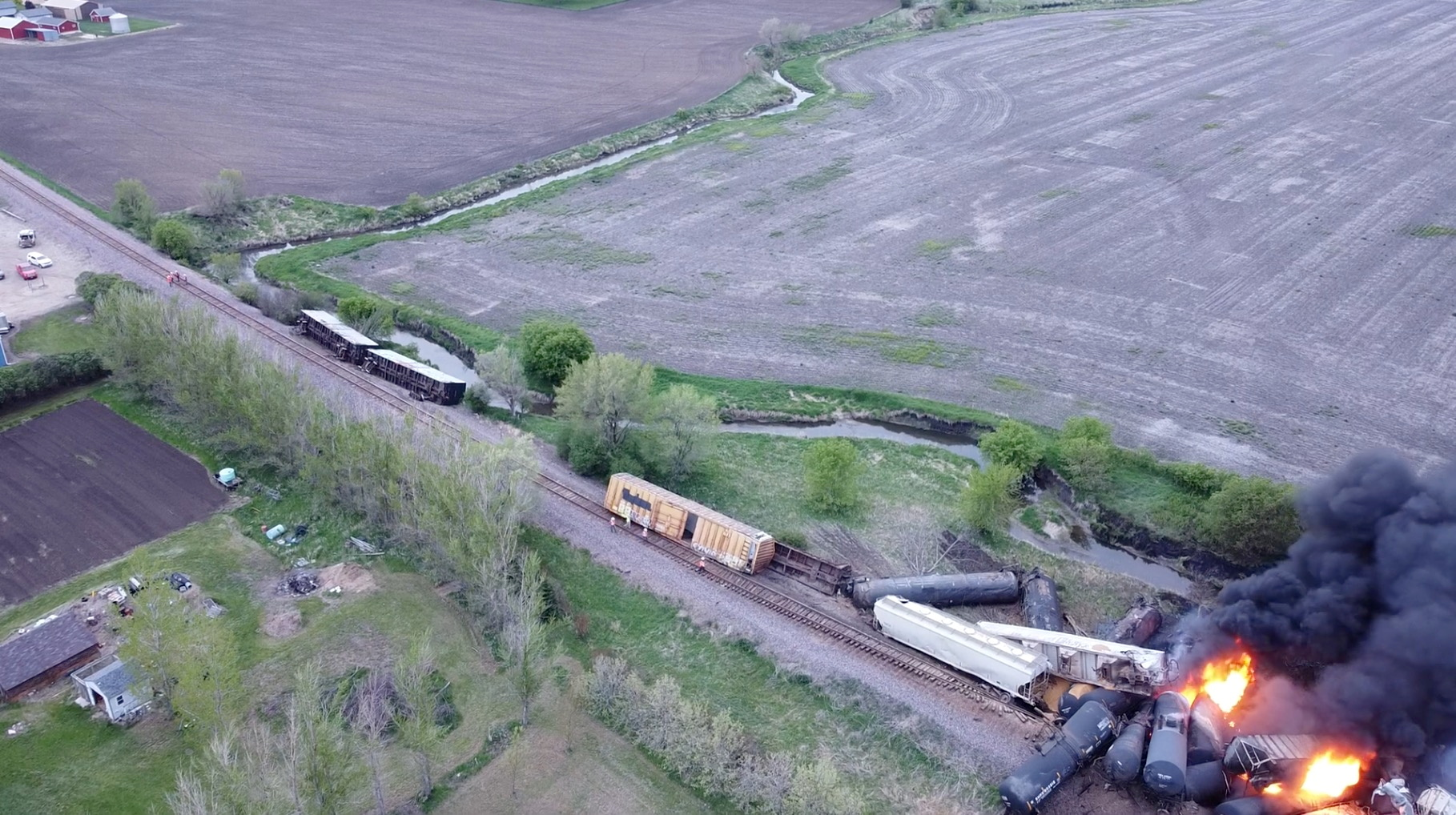 Fire is seen on a Union Pacific train carrying hazardous material that has derailed in Sibley, Iowa, U.S., in this still frame obtained from social media drone video dated May 16, 2021. NATHAN MINTEN/via REUTERS
