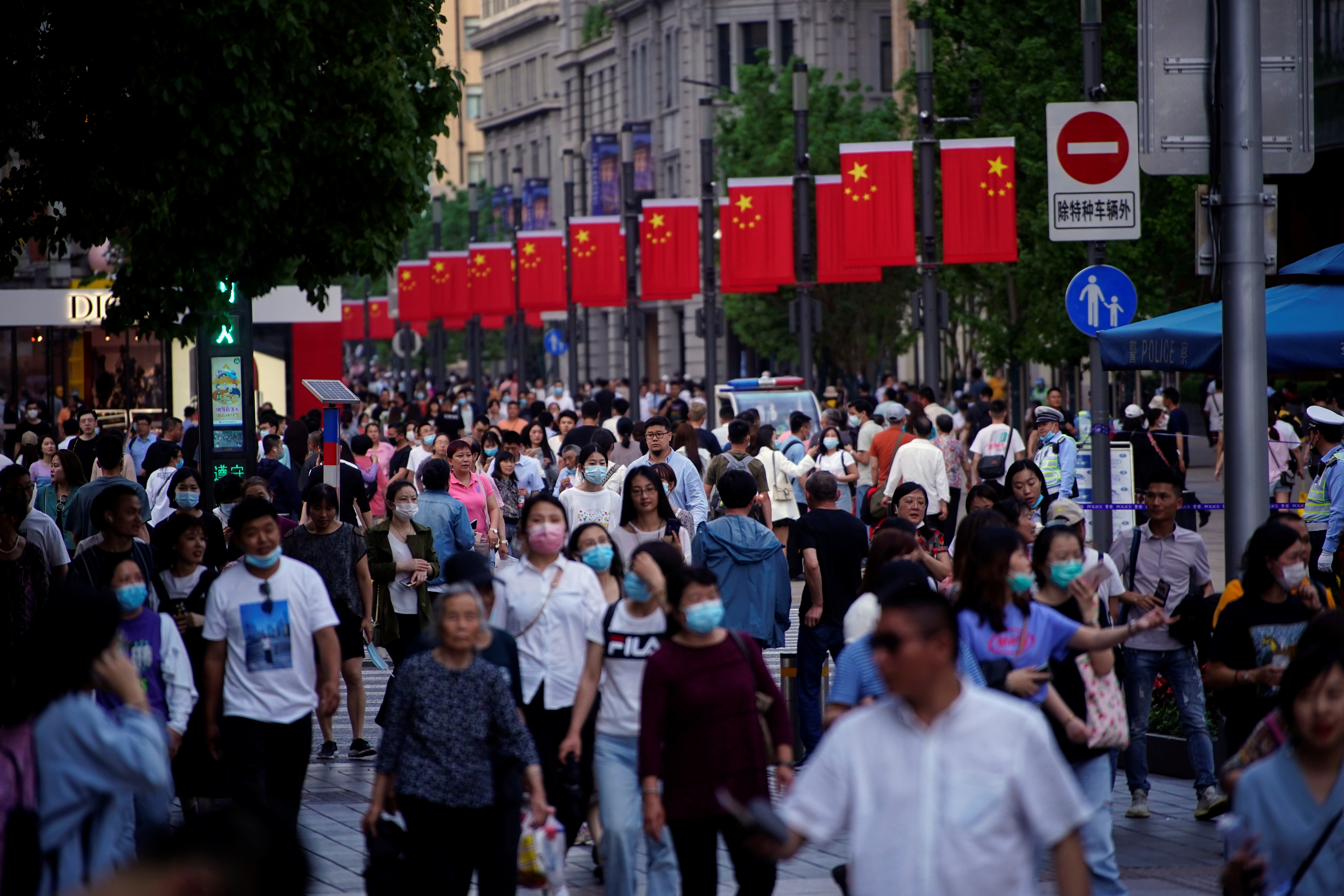 People walk along Nanjing Pedestrian Road, a main shopping area, following the outbreak of the coronavirus disease (COVID-19), in Shanghai, China May 10, 2021. REUTERS/Aly Song