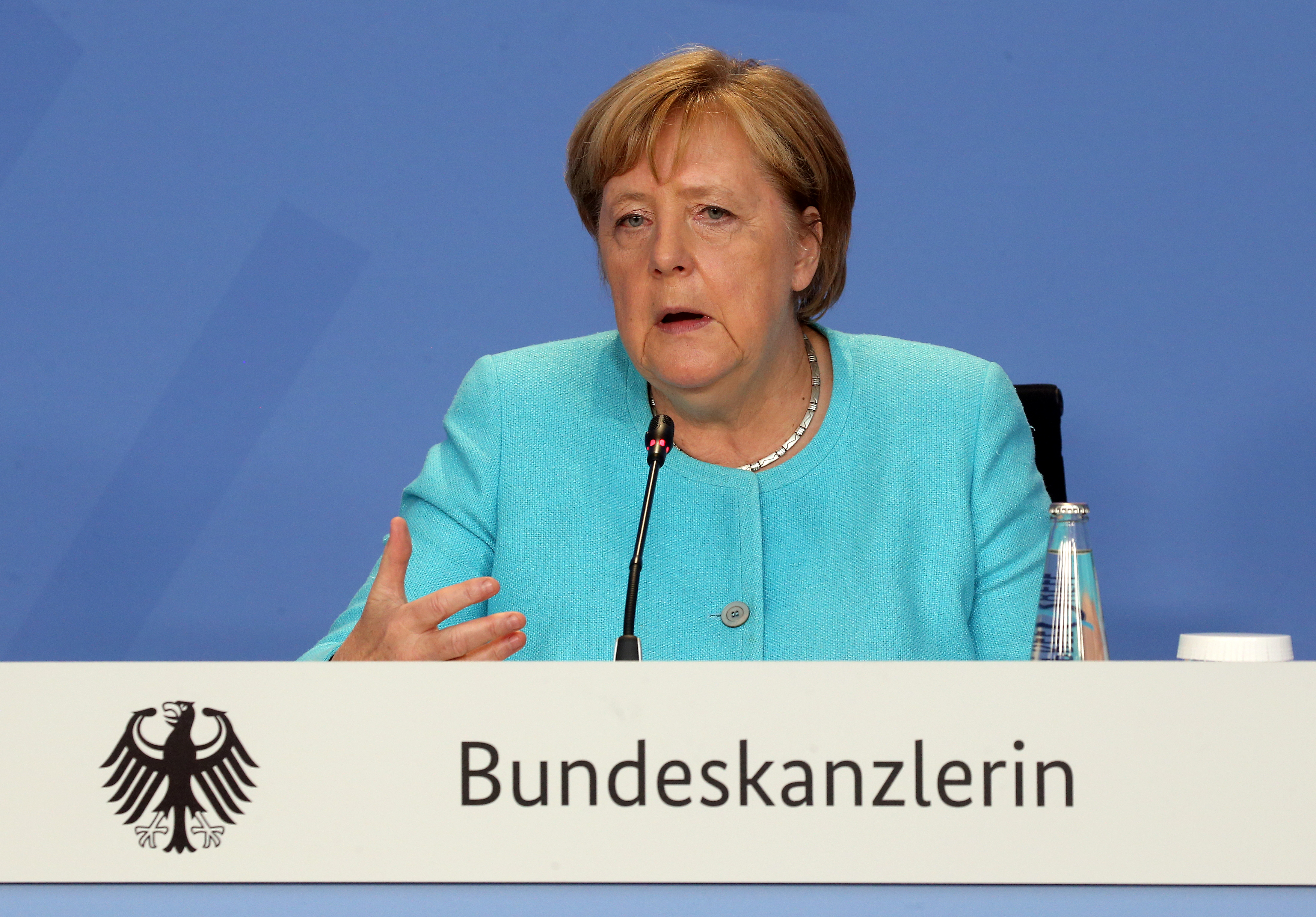 German Chancellor Angela Merkel attends a news conference after talks with directors of the ILO, IMF, OECD, World Bank and more to discuss questions on the current state of the global economic situation, in Berlin, Germany August 26, 2021. Wolfgang Kumm/Pool via REUTERS