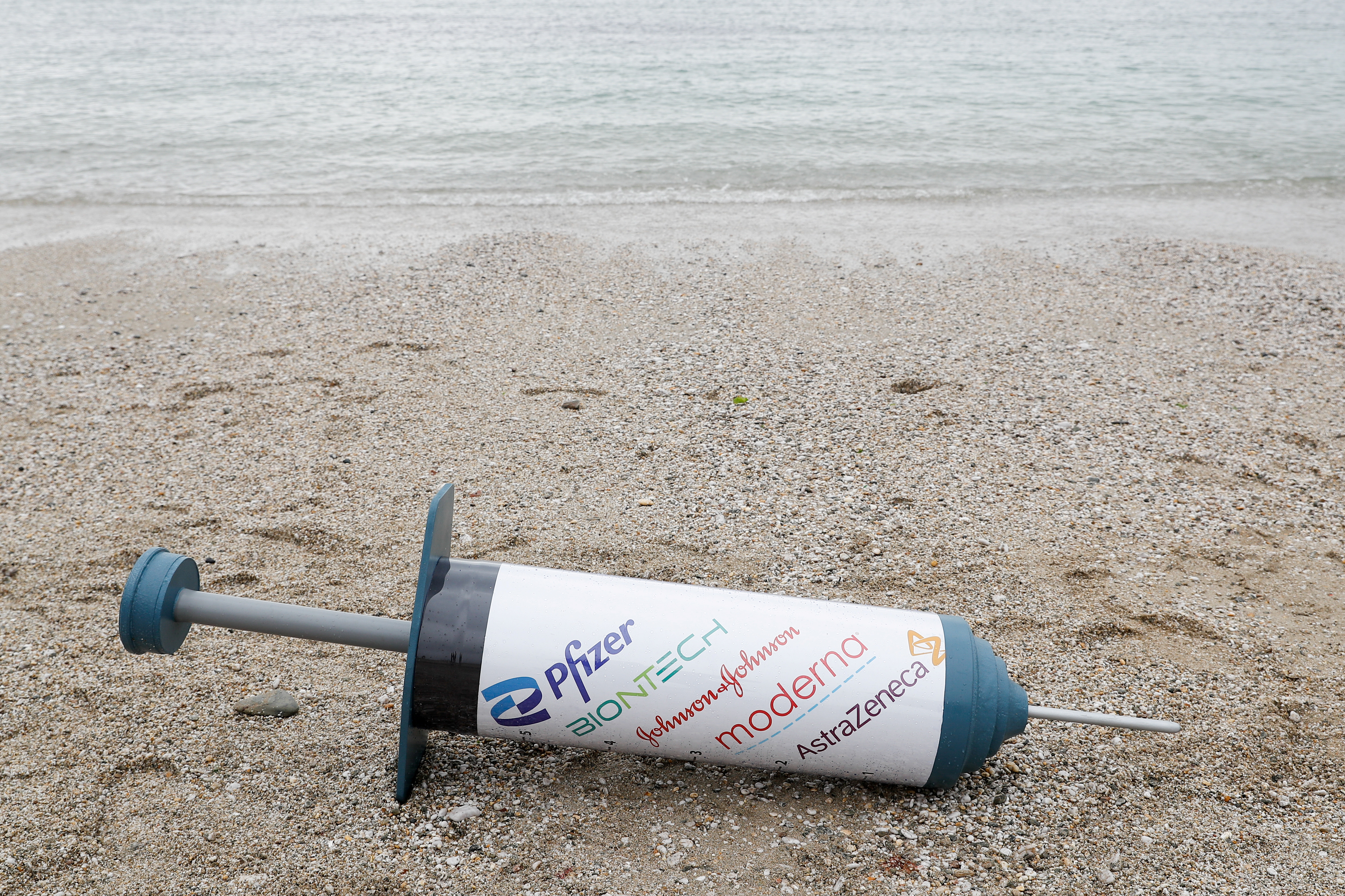 A prop vaccine is seen during a protest of Oxfam activists, at a beach near Falmouth, on the sidelines of G7 summit, in Cornwall, Britain, June 11, 2021.  REUTERS/Peter Nicholls