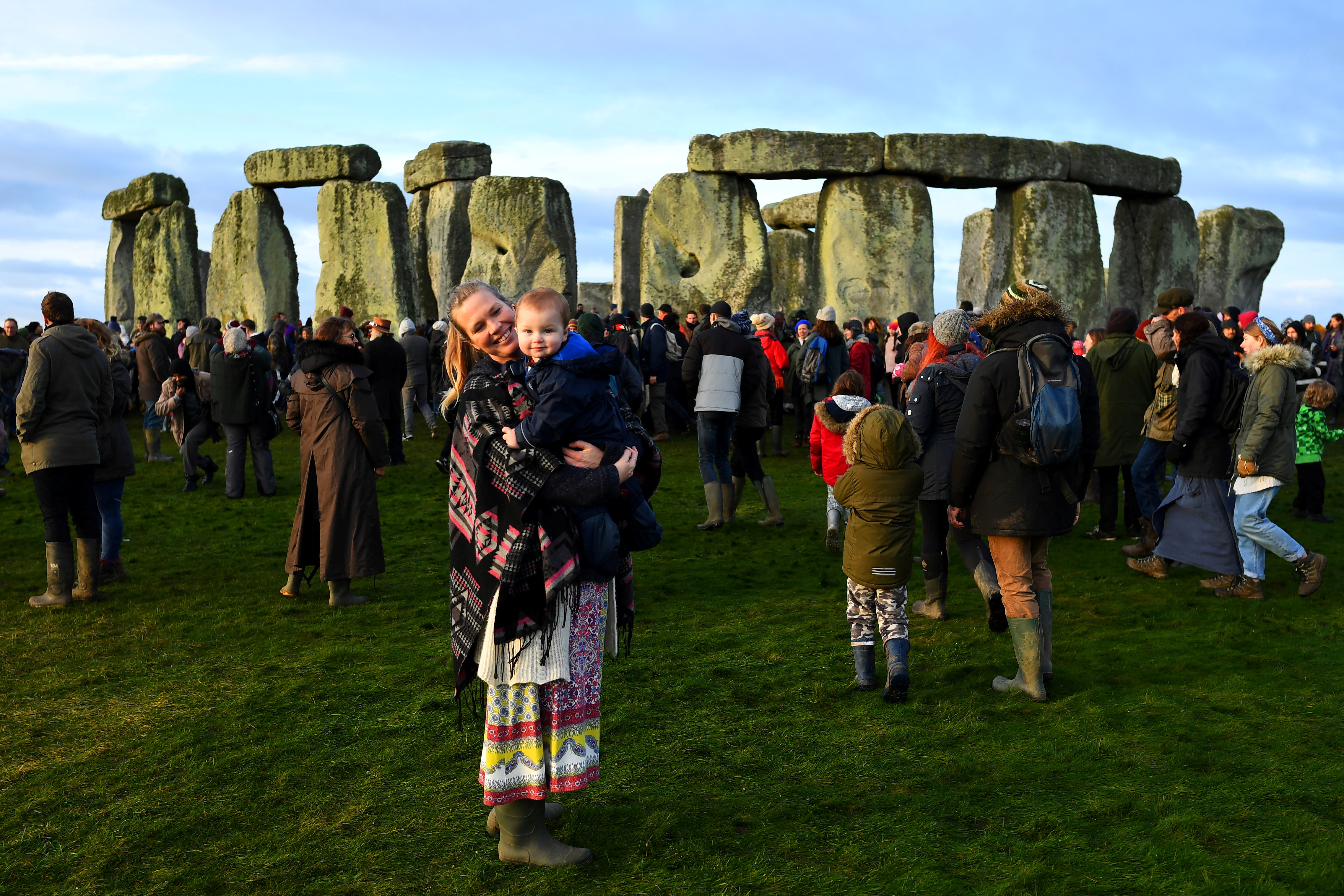 Ann Owen poses with her 11-month-old son Forrest, as they welcome the winter solstice at Stonehenge stone circle in Amesbury, Britain, December 22, 2019.  REUTERS/Dylan Martinez/File Photo