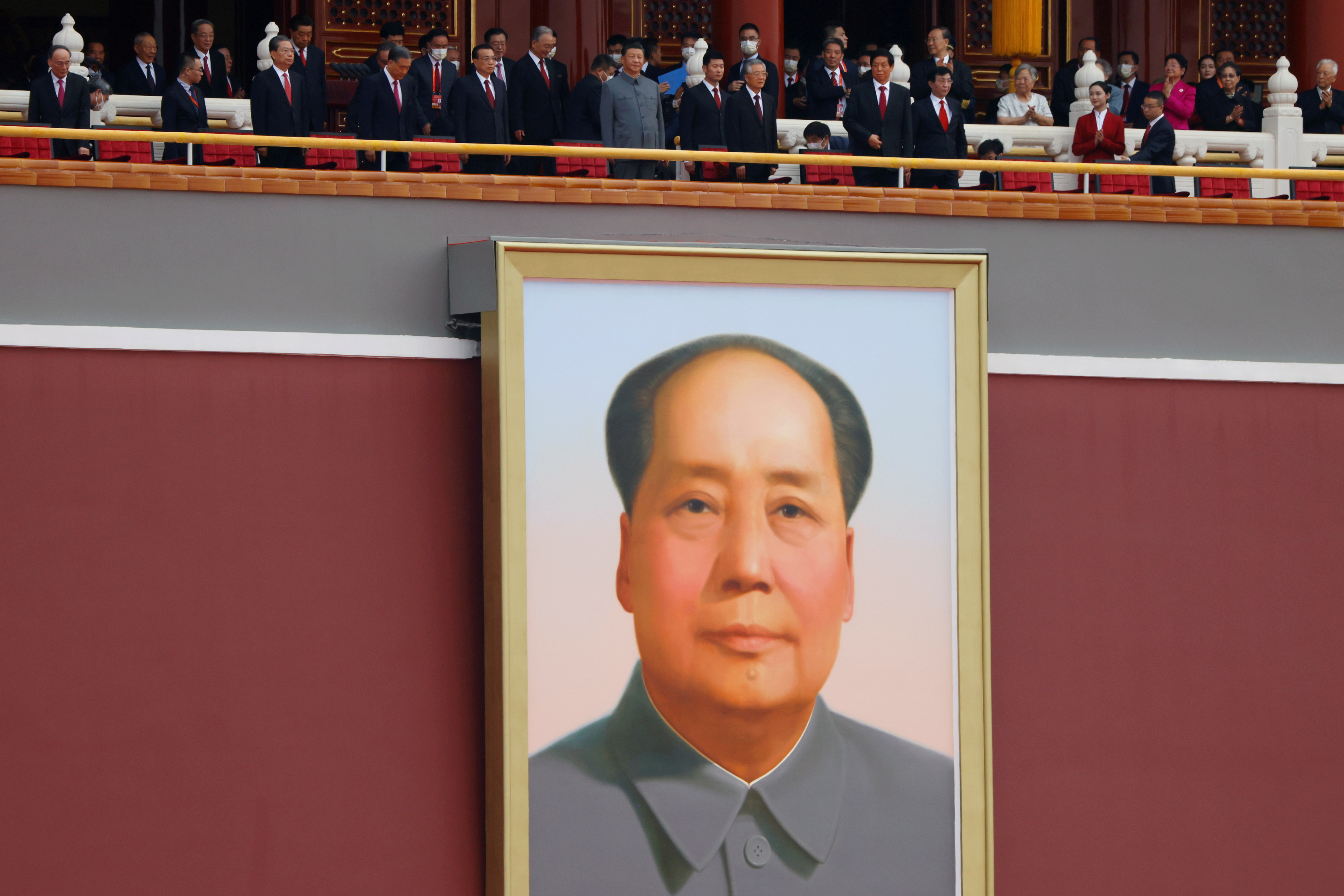 Chinese President Xi Jinping and other leaders stand above a giant portrait of late Chinese chairman Mao Zedong as they arrive for the event marking the 100th founding anniversary of the Communist Party of China, on Tiananmen Square in Beijing, China July 1, 2021. REUTERS/Carlos Garcia Rawlins