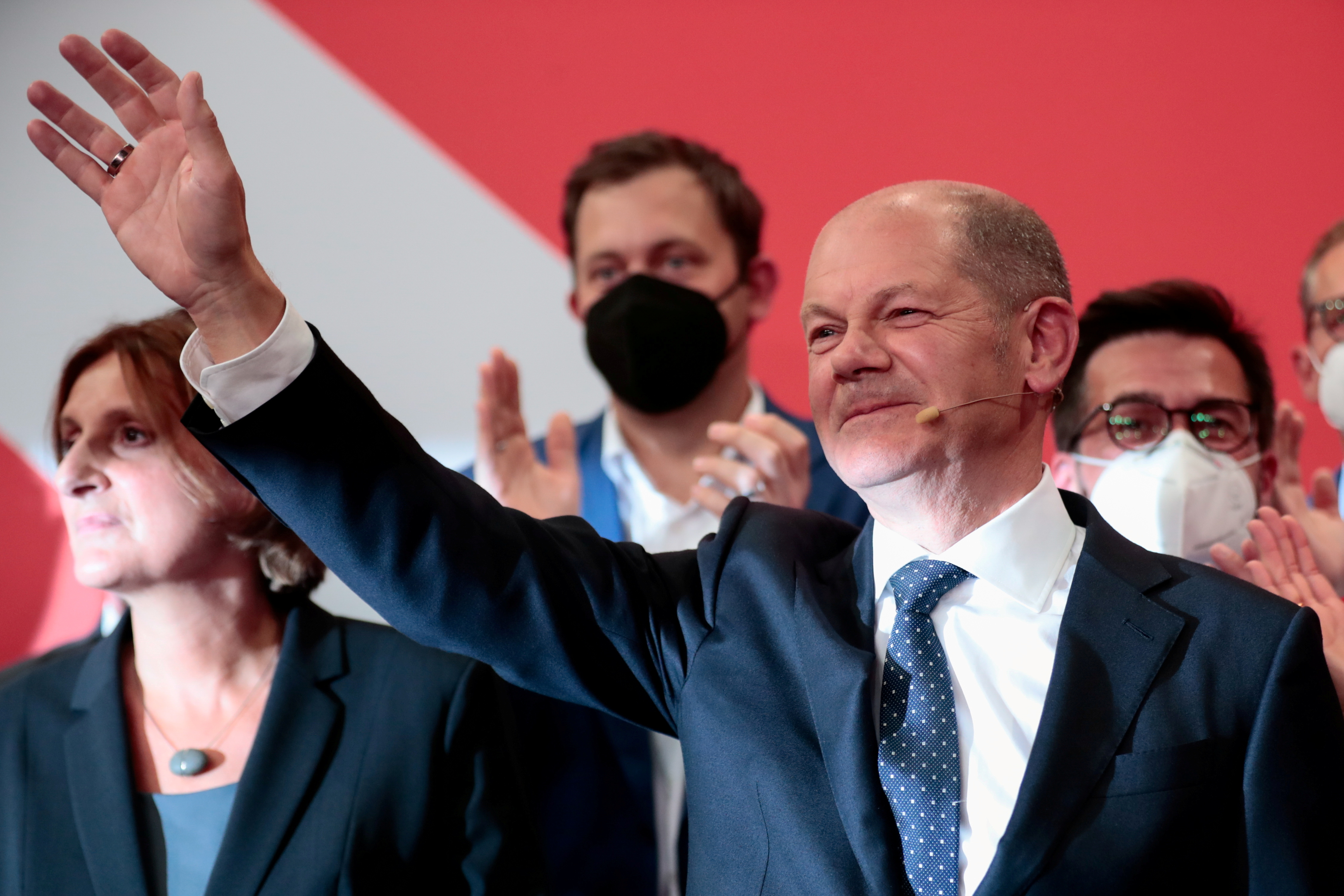 Social Democratic Party (SPD) top candidate for chancellor Olaf Scholz waves after first exit polls for the general elections in Berlin, Germany, September 26, 2021.    REUTERS/Hannibal Hanschke