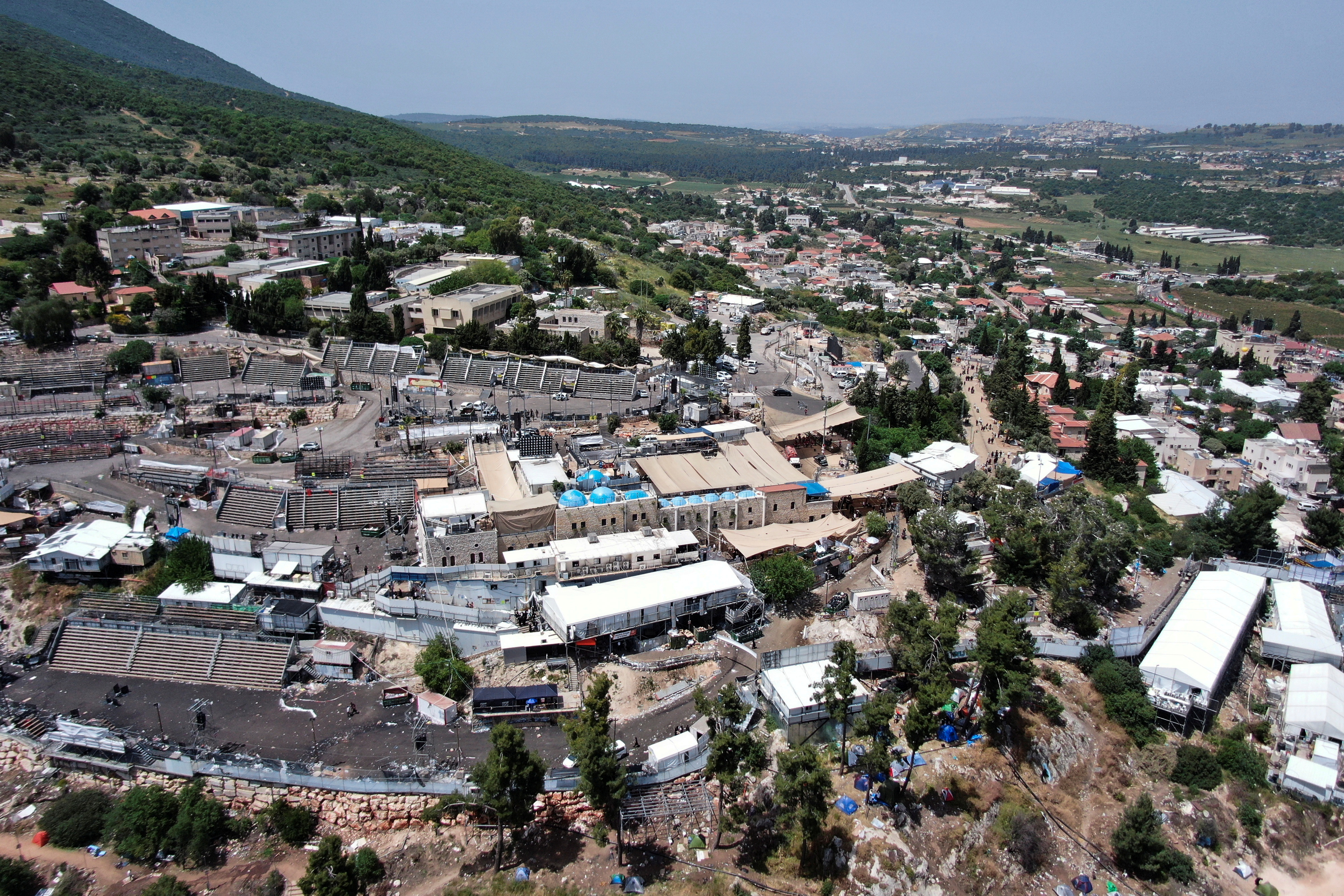 A view of Mount Meron where fatalities were reported among the thousands of ultra-Orthodox Jews, who gathered at the tomb of a 2nd-century sage for annual commemorations that include all-night prayer and dance, Israel April 30, 2021. Picture taken with a drone. REUTERS/Ilan Rosenberg