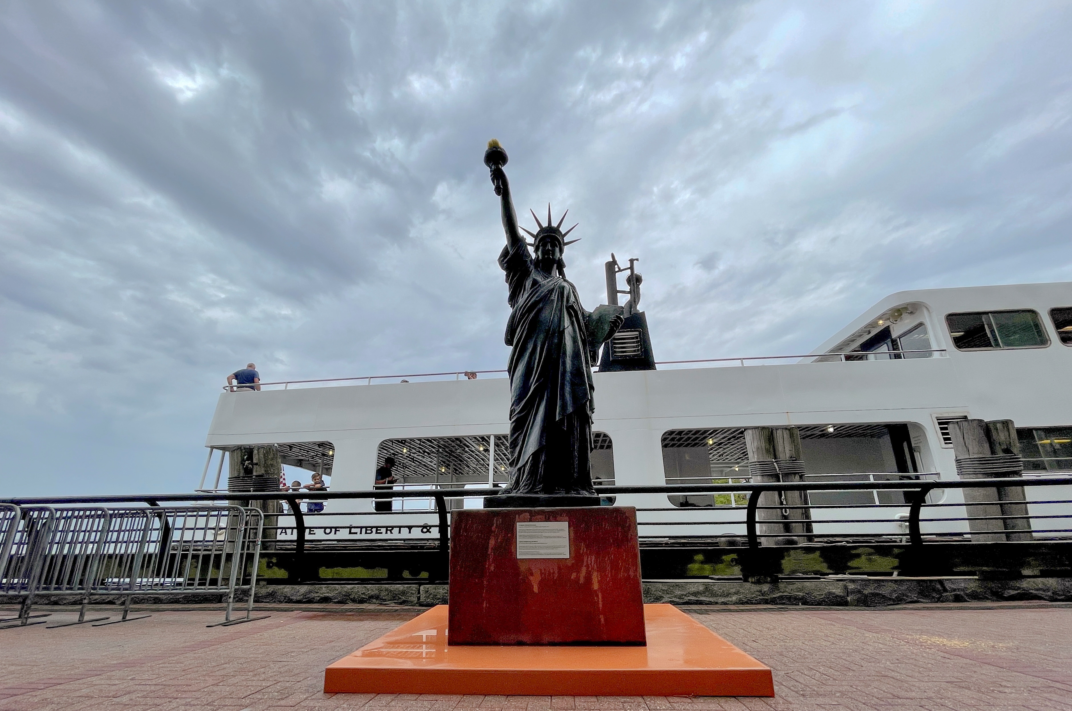 A replica Statue of Liberty is installed on Ellis Island across from her big sister in New York Harbor, New York City, New York, U.S., July 1, 2021. REUTERS/Roselle Chen