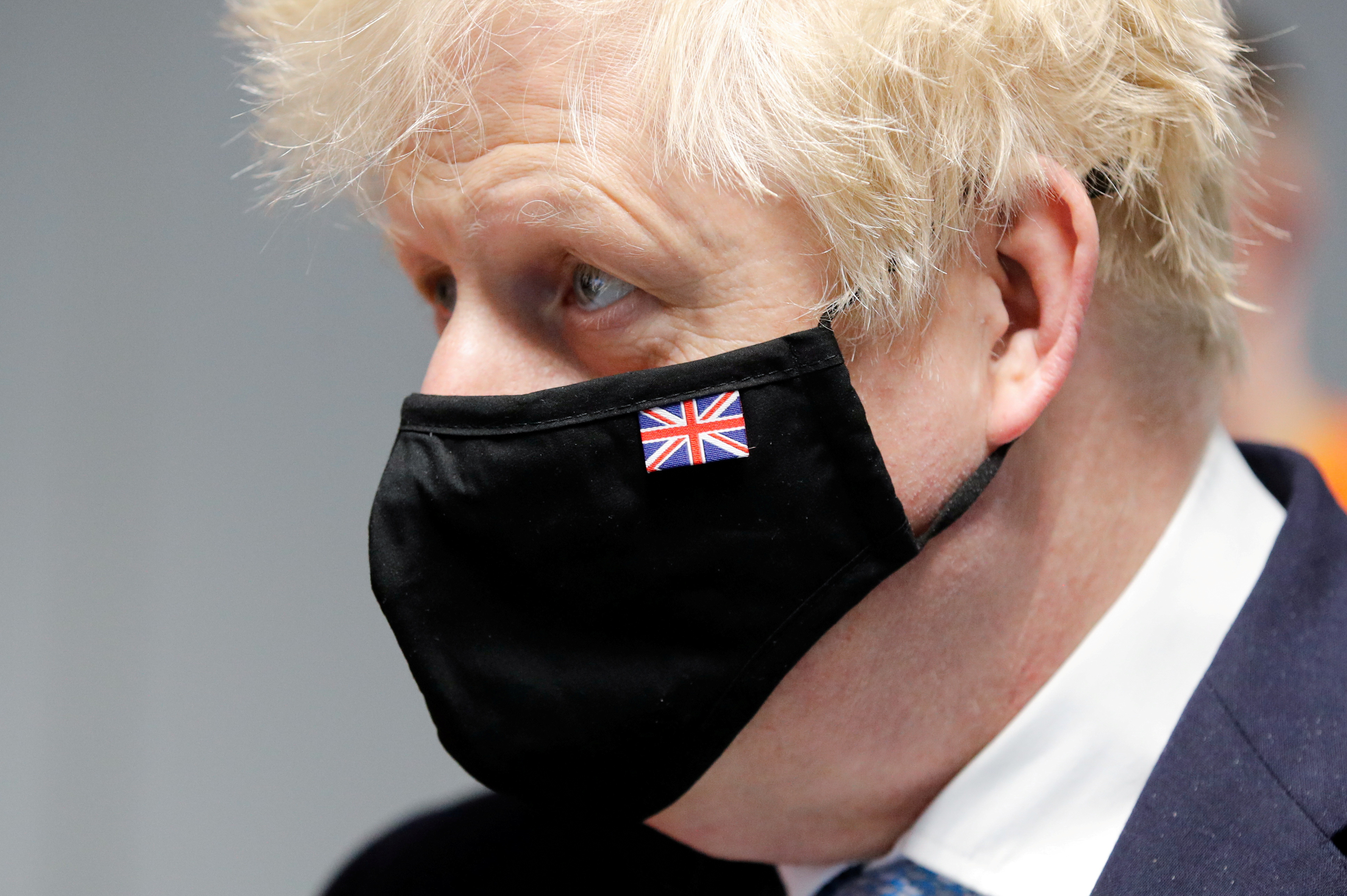 Britain's Prime Minister Boris Johnson wears a mask during a visit to Severn Trent Academy in Coventry, West Midlands, Britain, May 7, 2021. REUTERS/Phil Noble/Pool/File Photo