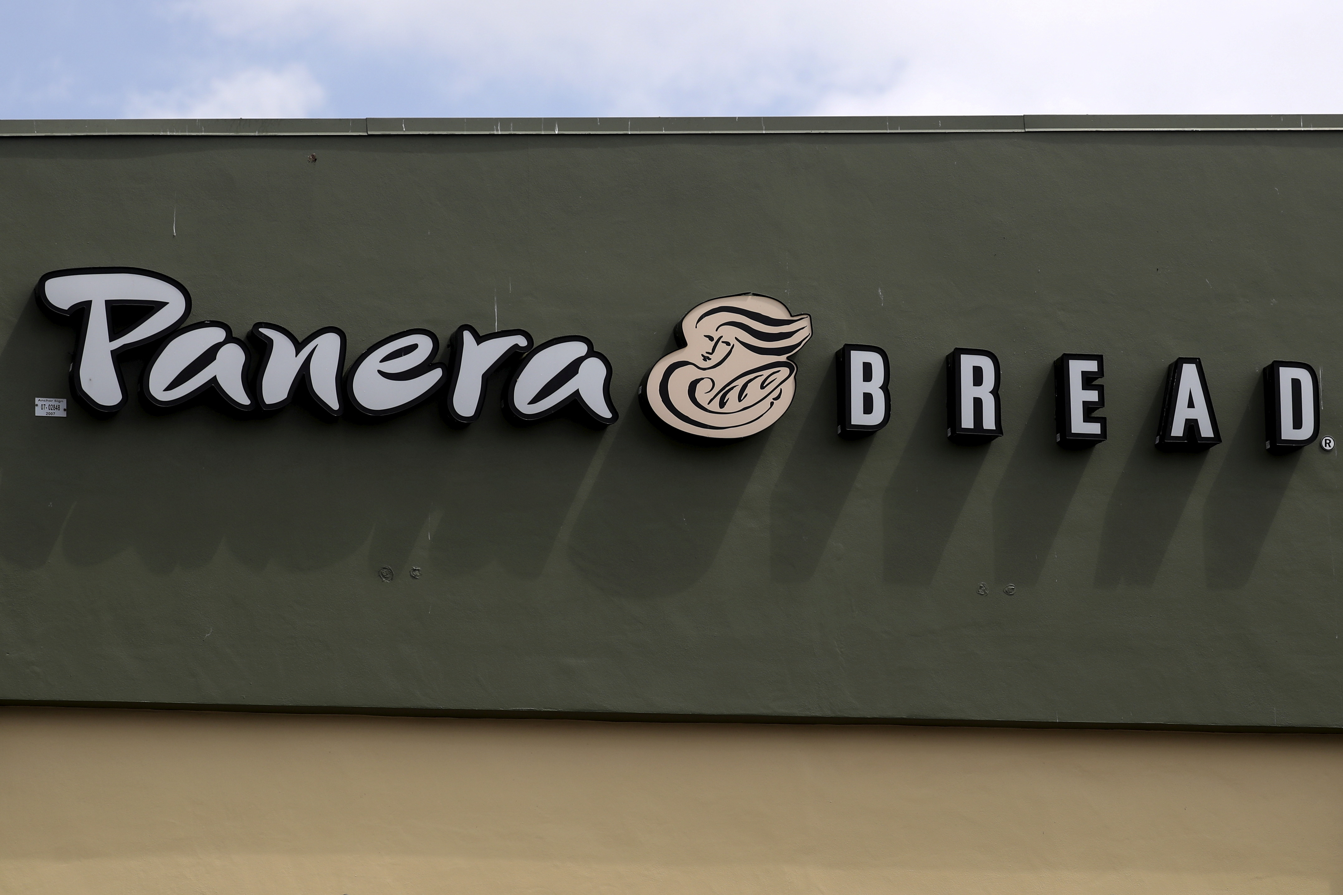 A Panera restaurant logo is pictured on a building in North Miami, Florida March 19, 2016. REUTERS/Carlo Allegri/File Photo