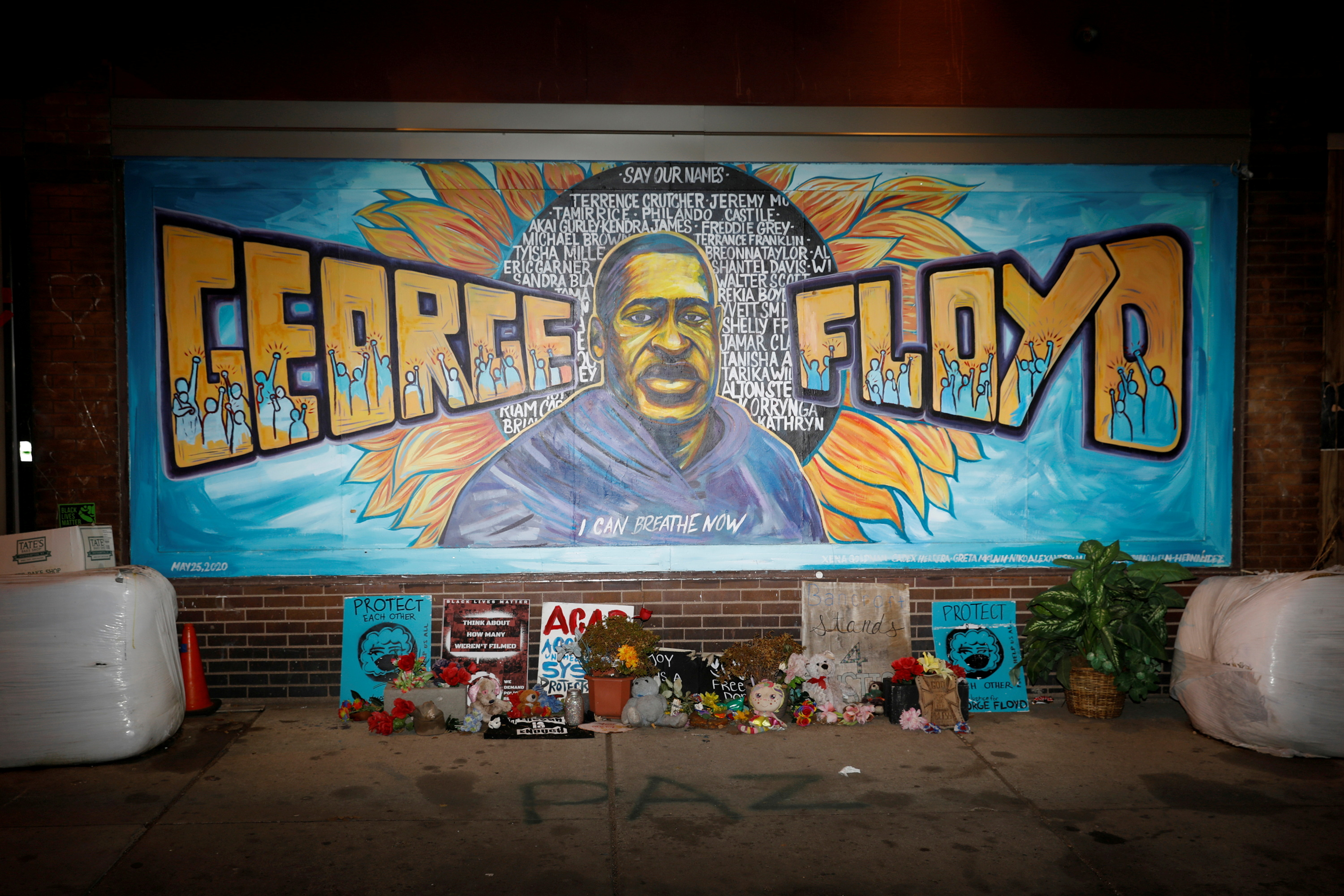 A view of the George Floyd mural at 38th Street and Chicago Avenue a day before opening statements in the trial of former police officer Derek Chauvin, who is facing murder charges in the death of George Floyd, in Minneapolis, Minnesota, U.S., March 28, 2021. REUTERS/Octavio Jones/File Photo