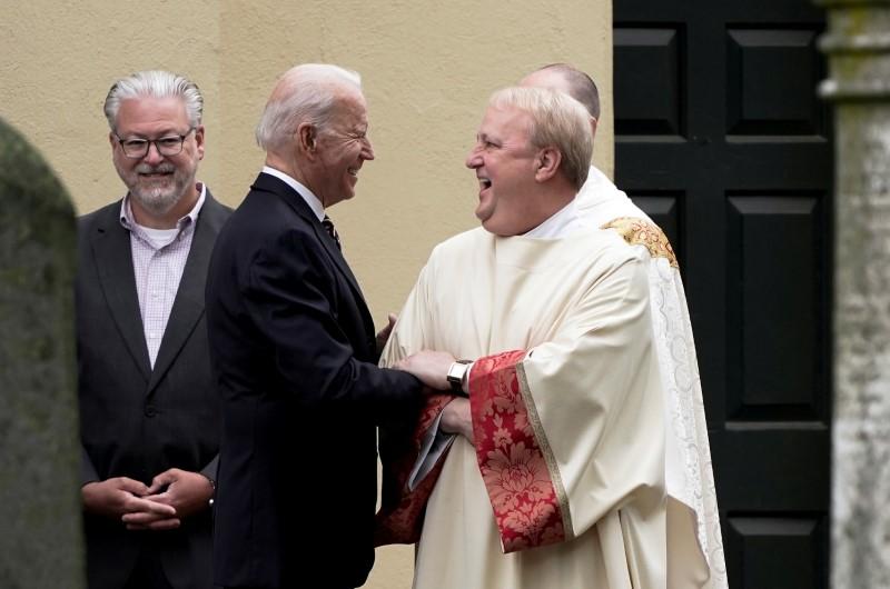 U.S. President Joe Biden speaks with a priest outside St. Joseph on the Brandywine Catholic Church, in Wilmington, Delaware, U.S. May 30, 2021. REUTERS/Ken Cedeno/File Photo