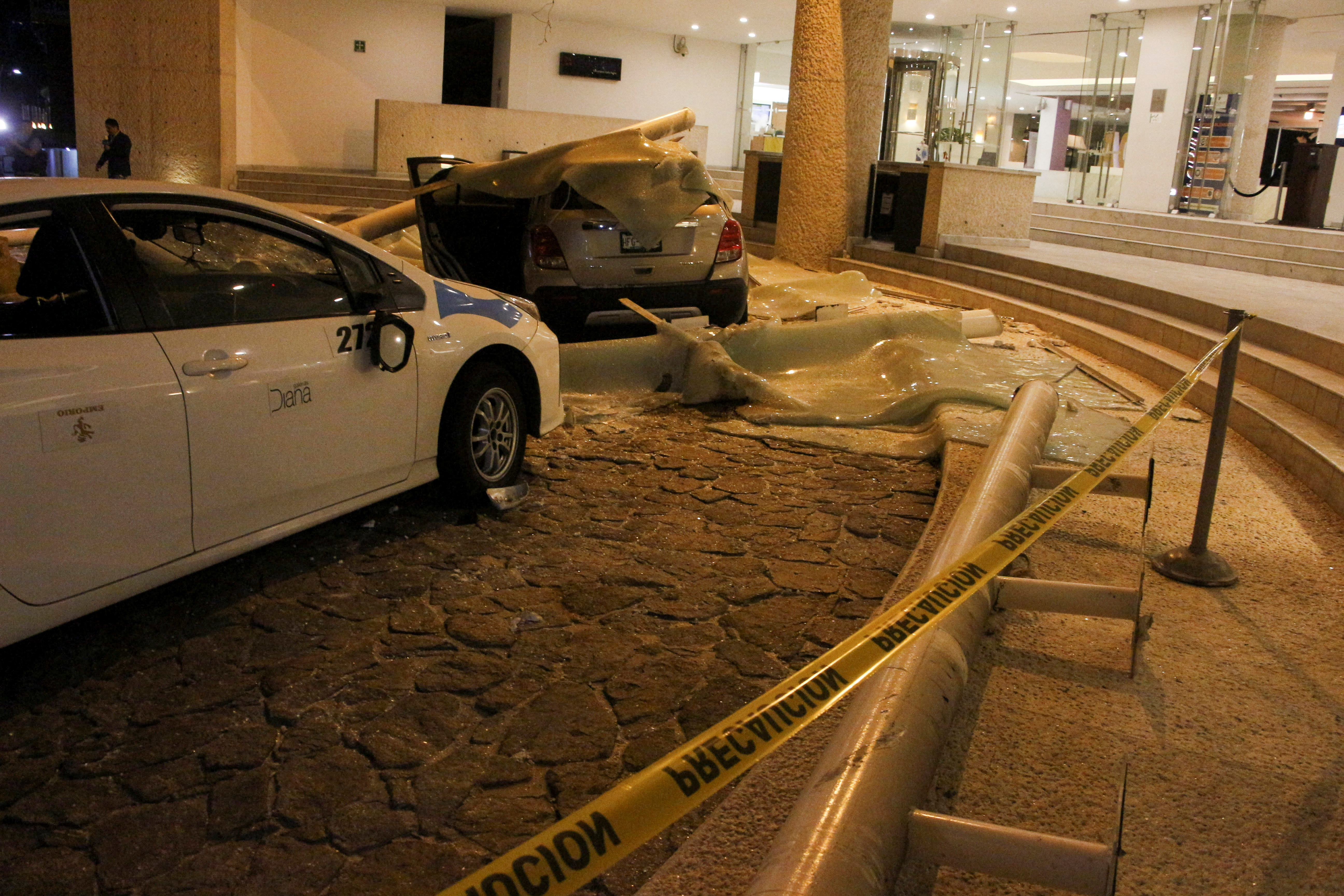 Cars damaged during a quake are pictured at the Hotel Emporio in Acapulco, Mexico September 7, 2021.  REUTERS/Stringer