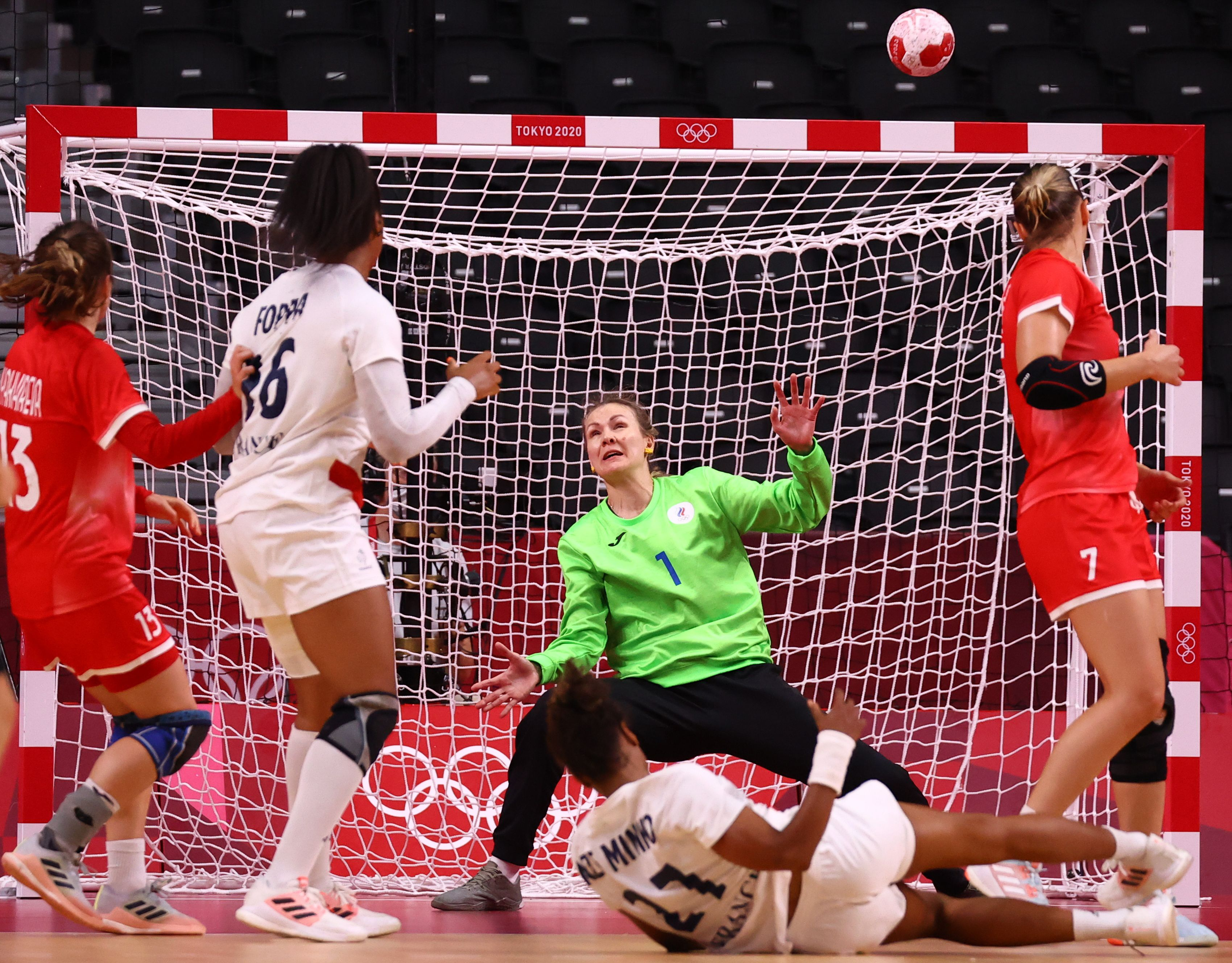 Tokyo 2020 Olympics - Handball - Women - Group B - Russian Olympic Committee v France - Yoyogi National Stadium - Tokyo, Japan - July 31, 2021. Anna Sedoykina of the Russian Olympic Committee saves a shot taken by Estelle Nze Minko of France REUTERS/Leah Millis