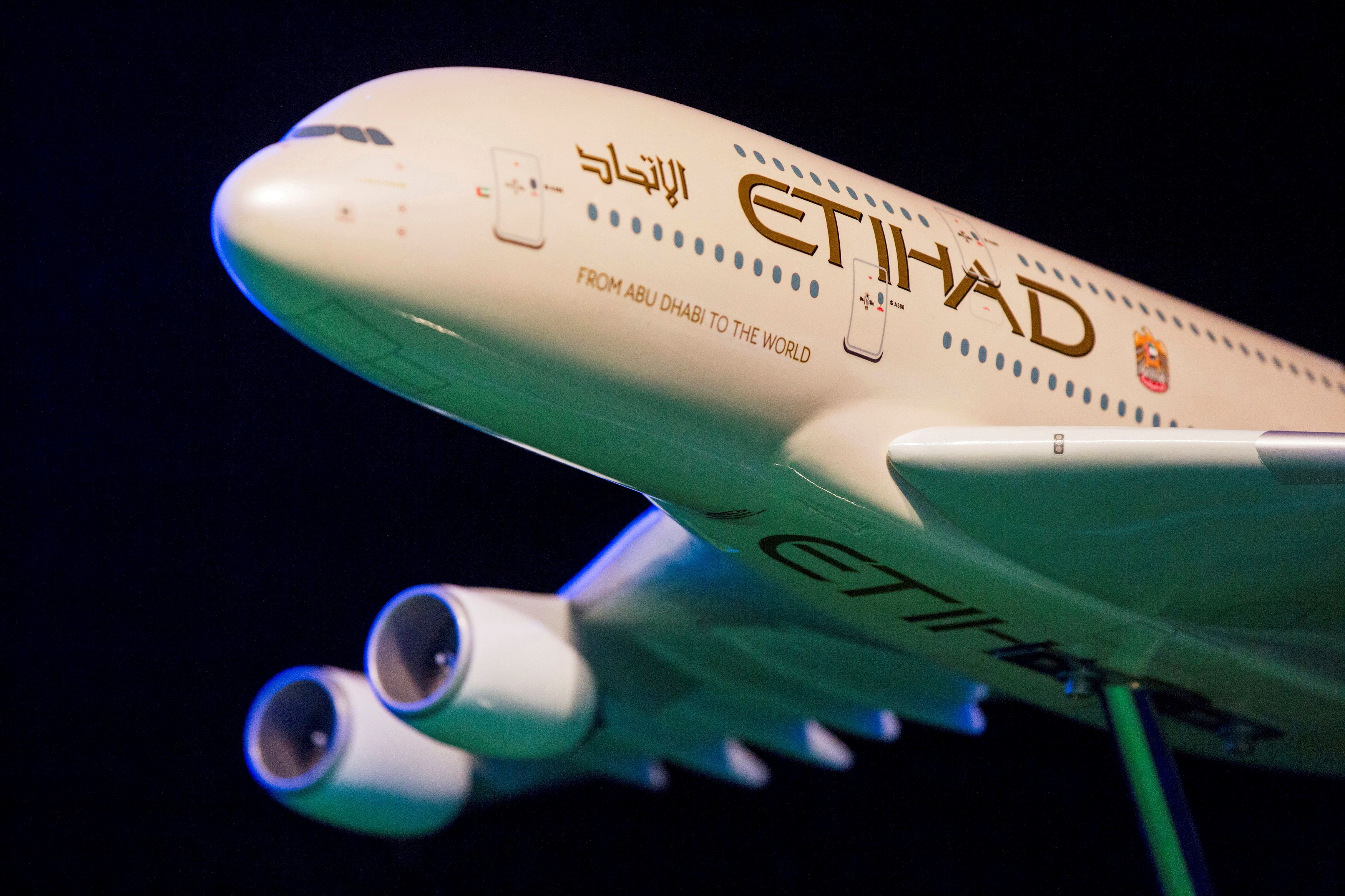 A model Etihad Airways plane is seen on stage in New York, U.S. November 13, 2014.  REUTERS/Lucas Jackson/File Photo