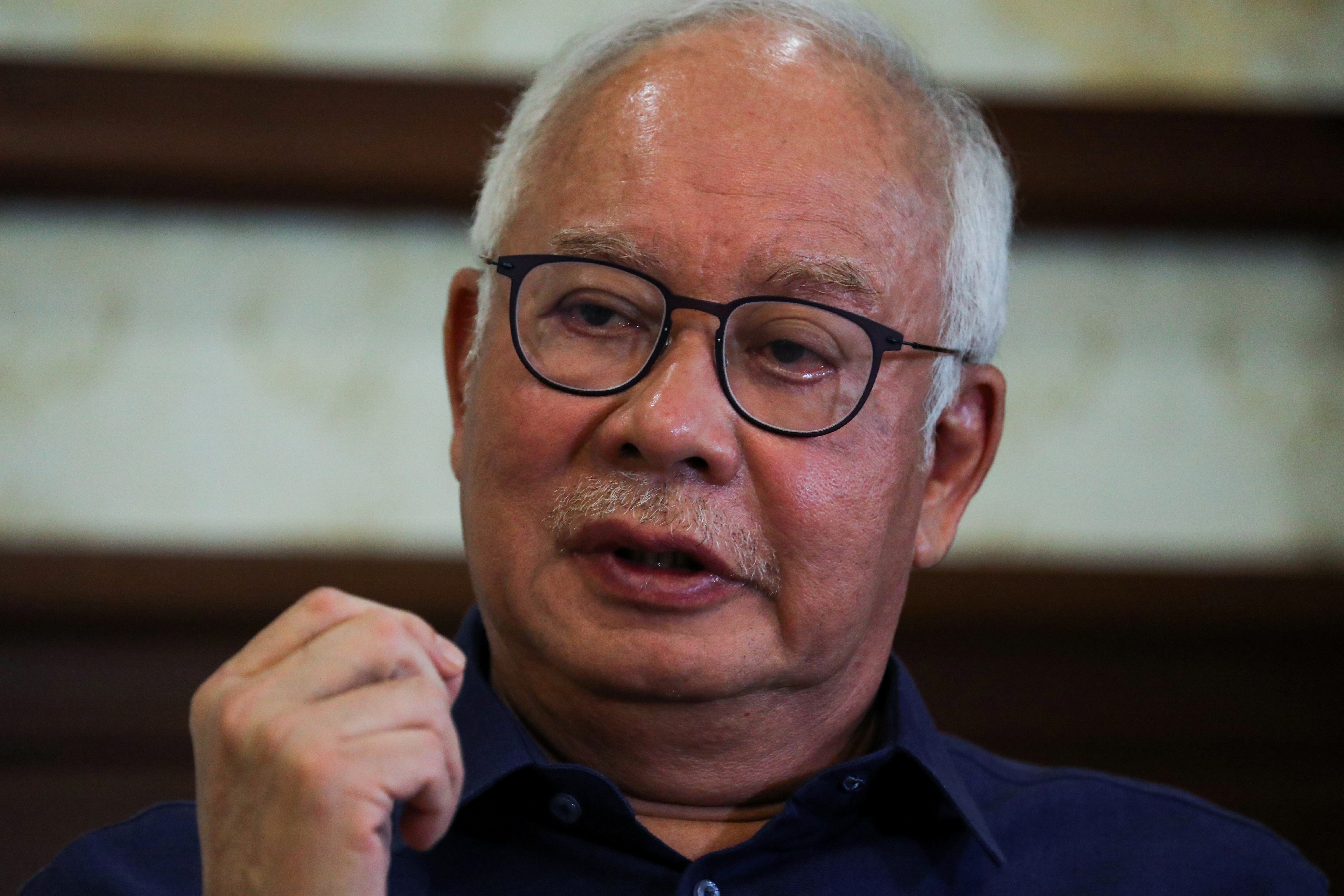 Malaysia's former Prime Minister Najib Razak speaks during an interview with Reuters in Kuala Lumpur, Malaysia September 18, 2021. Picture taken September 18, 2021. REUTERS/Lim Huey Teng