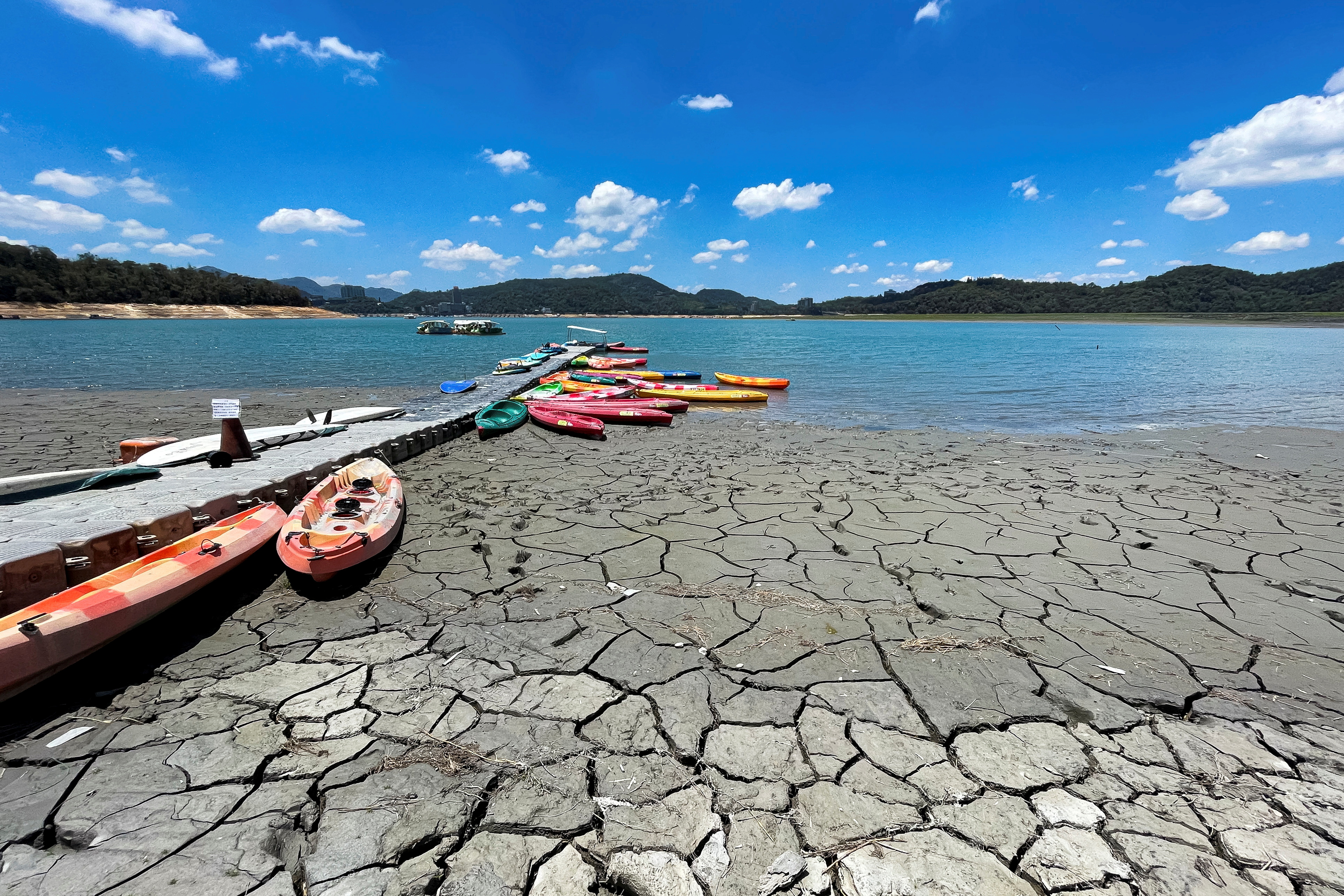 Boats sit at a pier on Sun Moon Lake with low water levels during an islandwide drought, in Nantou, Taiwan May 15, 2021. REUTERS/Annabelle Chih