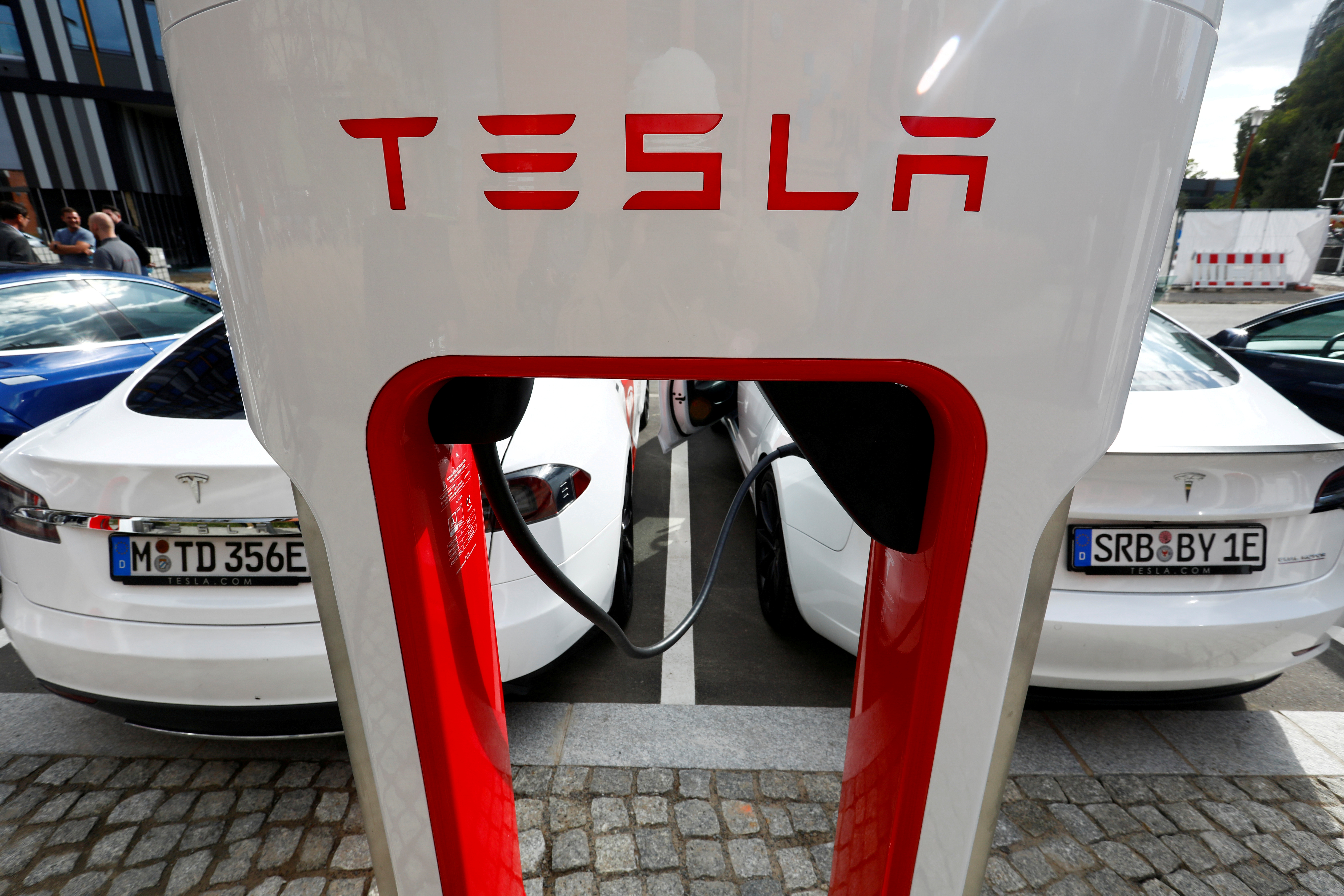 The company logo of Tesla cars is seen on the V3 supercharger equipment during the presentation of the new charge system in the EUREF campus in Berlin, Germany September 10, 2020. REUTERS/Michele Tantussi/File Photo/File Photo