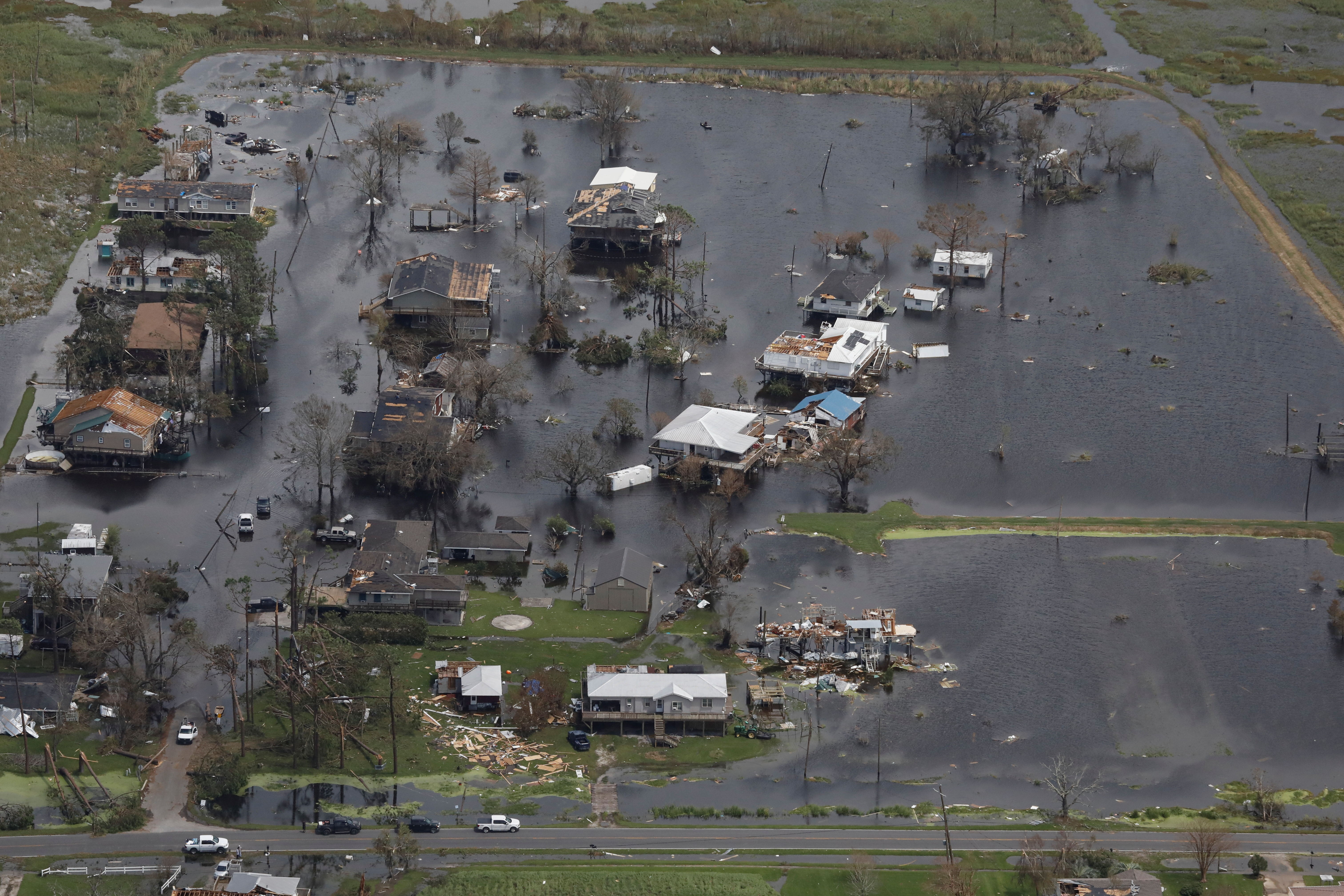 An aerial view shows destroyed houses in a flooded area after Hurricane Ida made landfall in Louisiana, in Montegut, Louisiana, U.S. August 31, 2021. REUTERS/Marco Bello