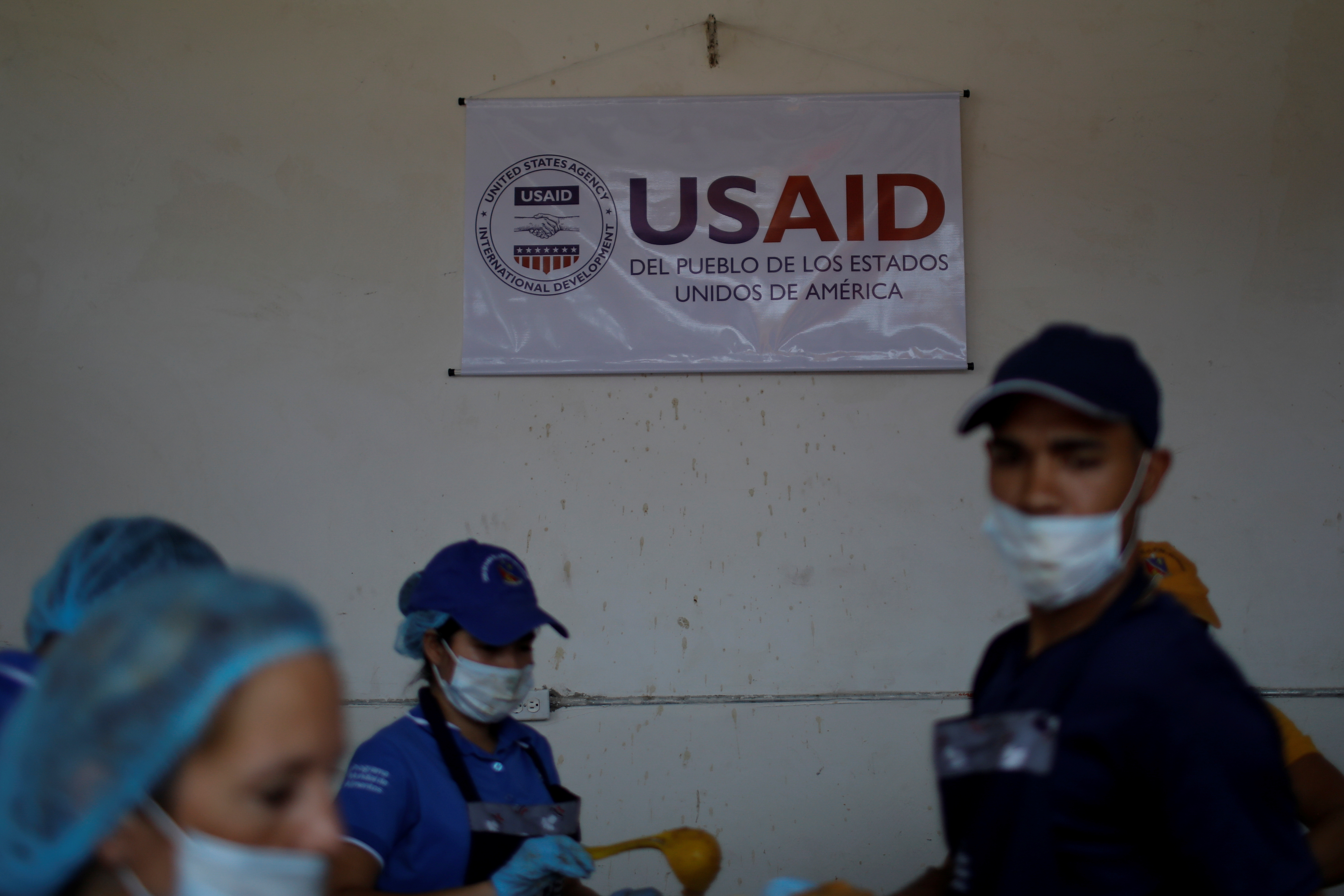 The logo of USAID is seen at a community kitchen set-up by them and the World Food Programme in Cucuta, Colombia February 7, 2019. REUTERS/Marco Bello/File Photo