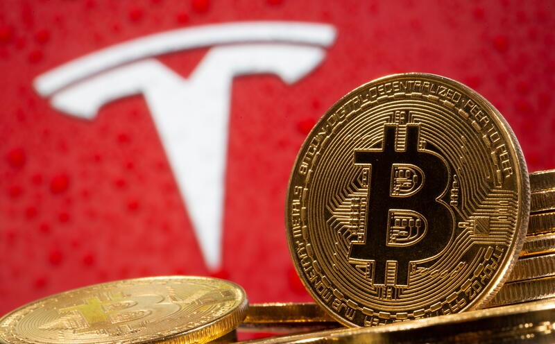 Bitcoin tops $40,000 after Musk says Tesla could use it again | Reuters