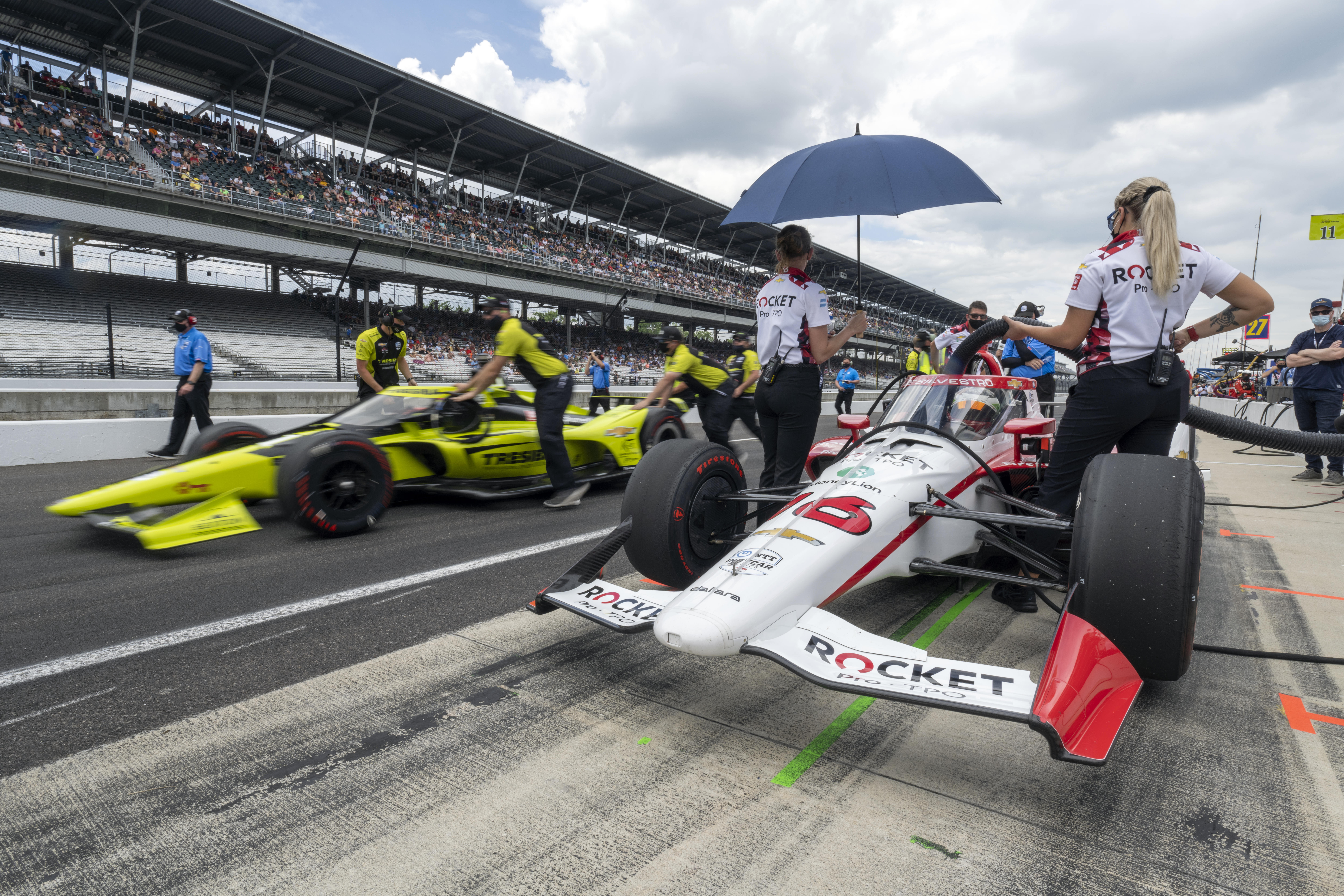 May 23, 2021; Indianapolis, IN, USA;A.J Foyt Enterprises driver Charlie Kimball (11) passes Rocket Pro TPO/Paretta Autosport driver Simona De Silvestro (16) whom he must beat in order to be eligible to race during last chance qualifications for the 2021 Indianapolis 500 at the Indianapolis Motor Speedway. / Marc Lebryk-USA TODAY Sports/File Photo
