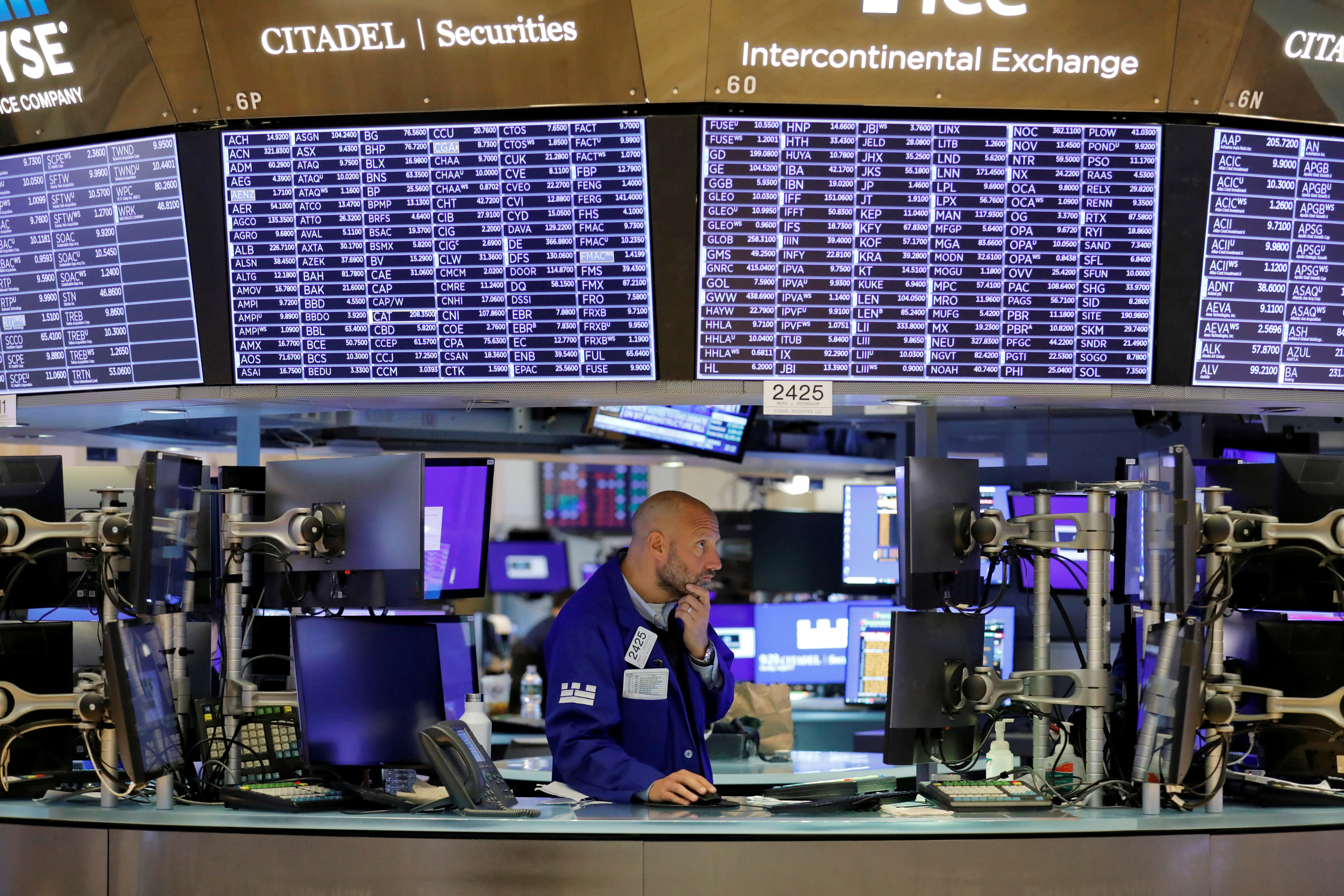 A trader works on the trading floor at the New York Stock Exchange (NYSE) in Manhattan, New York City, U.S., August 9, 2021. REUTERS/Andrew Kelly/File Photo