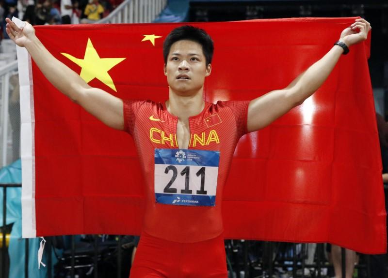 Athletics - 2018 Asian Games - Men's 100m Final - GBK Main Stadium - Jakarta, Indonesia - August 26, 2018 - Su Bingtian of China celebrates after winning the gold medal. REUTERS/Issei Kato