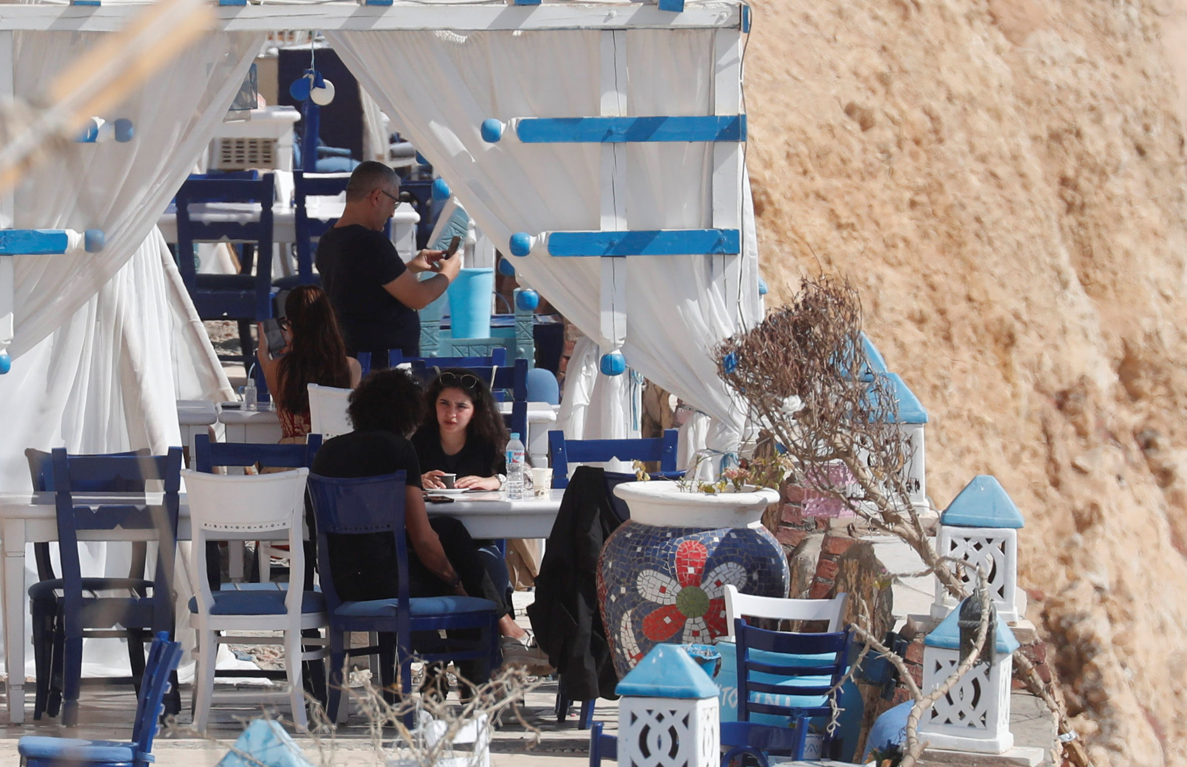Tourists take lunch on a mountain restaurant amid the coronavirus disease (COVID-19) pandemic in the Red Sea resort of Sharm el-Sheikh, south of Cairo, Egypt February 6, 2021. REUTERS/Amr Abdallah Dalsh