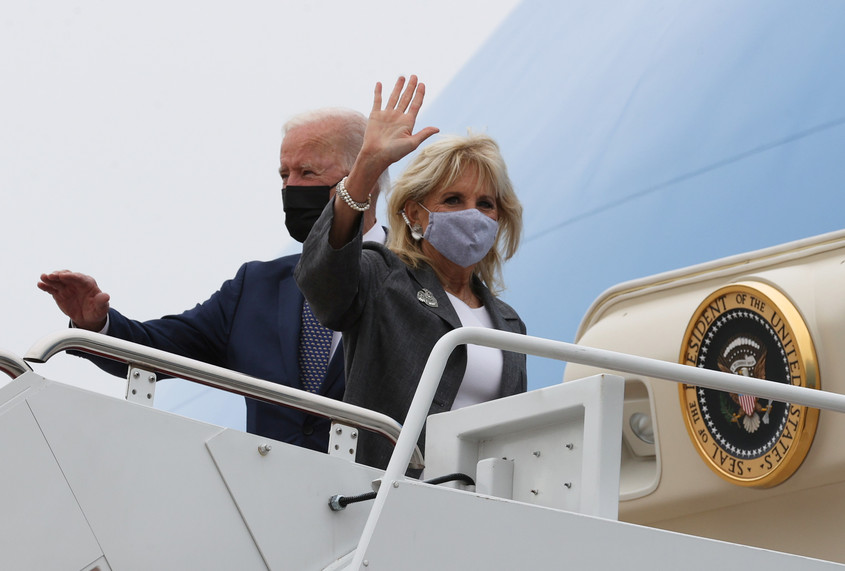 U.S. President Joe Biden and first lady Jill Biden wave as they board Air Force One for travel to Virginia from Joint Base Andrews, Maryland, U.S. May 3, 2021.  REUTERS/Jonathan Ernst