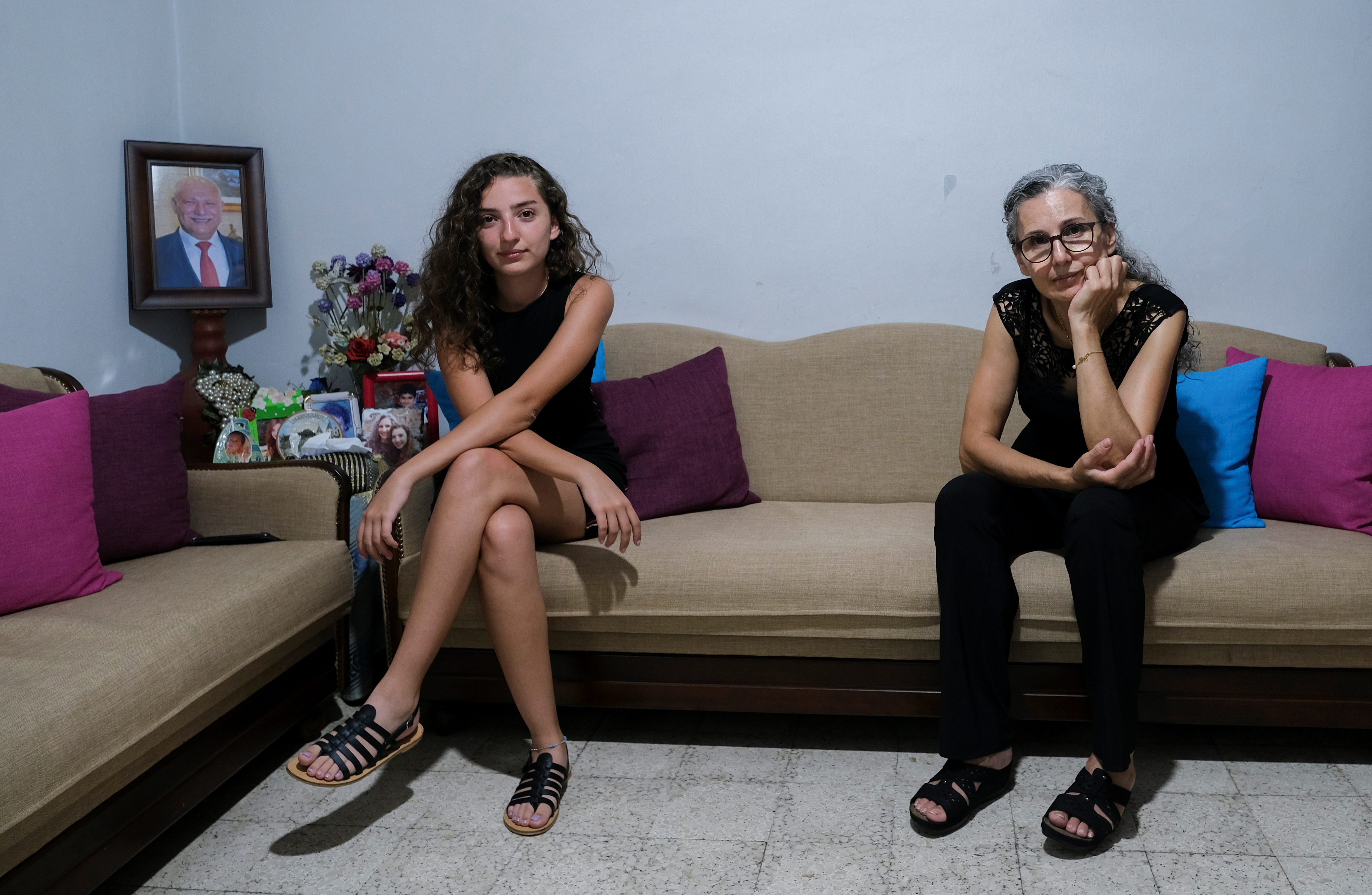 Tatiana Hasrouty, whose father was killed in the August 4 explosion at Beirut port, poses with her mother Ibtissam in her family home in Sin El Fil, Lebanon July 19, 2021.