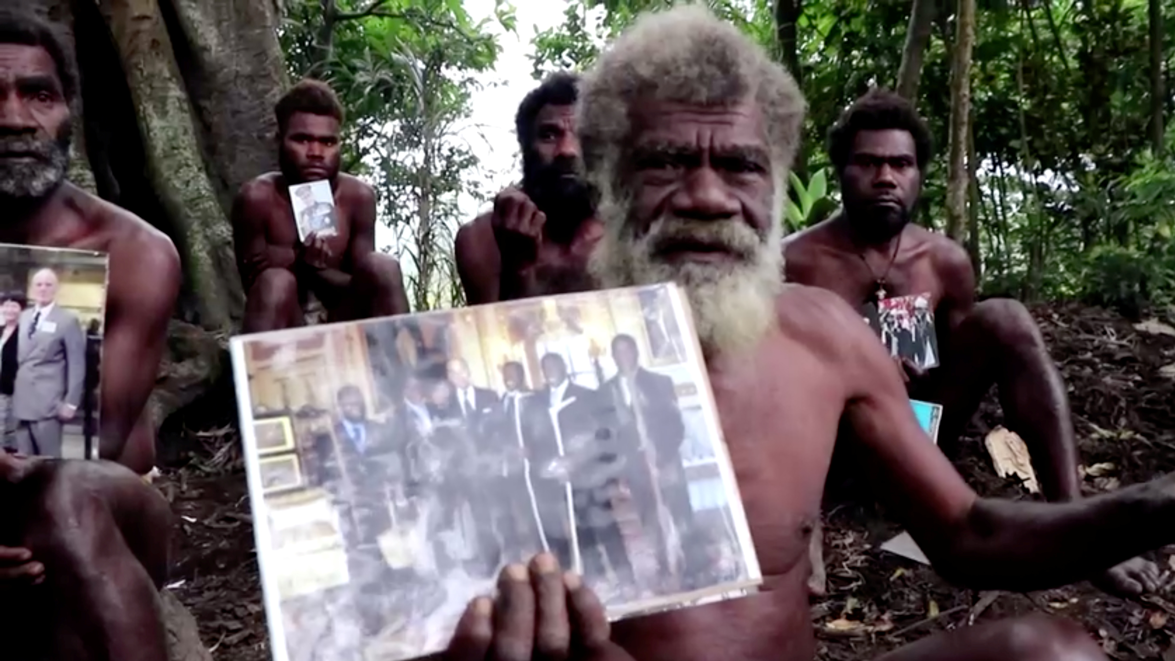 Ikunala village Chief Yapa holds photos of himself and four other local men with Britain's Prince Philip, taken during their 2007 trip to England, as he sends their condolences after the prince passed away at age 99 on Friday, in Ikunala, Tanna island, Vanuatu April 11, 2021. Reuters TV via REUTERS