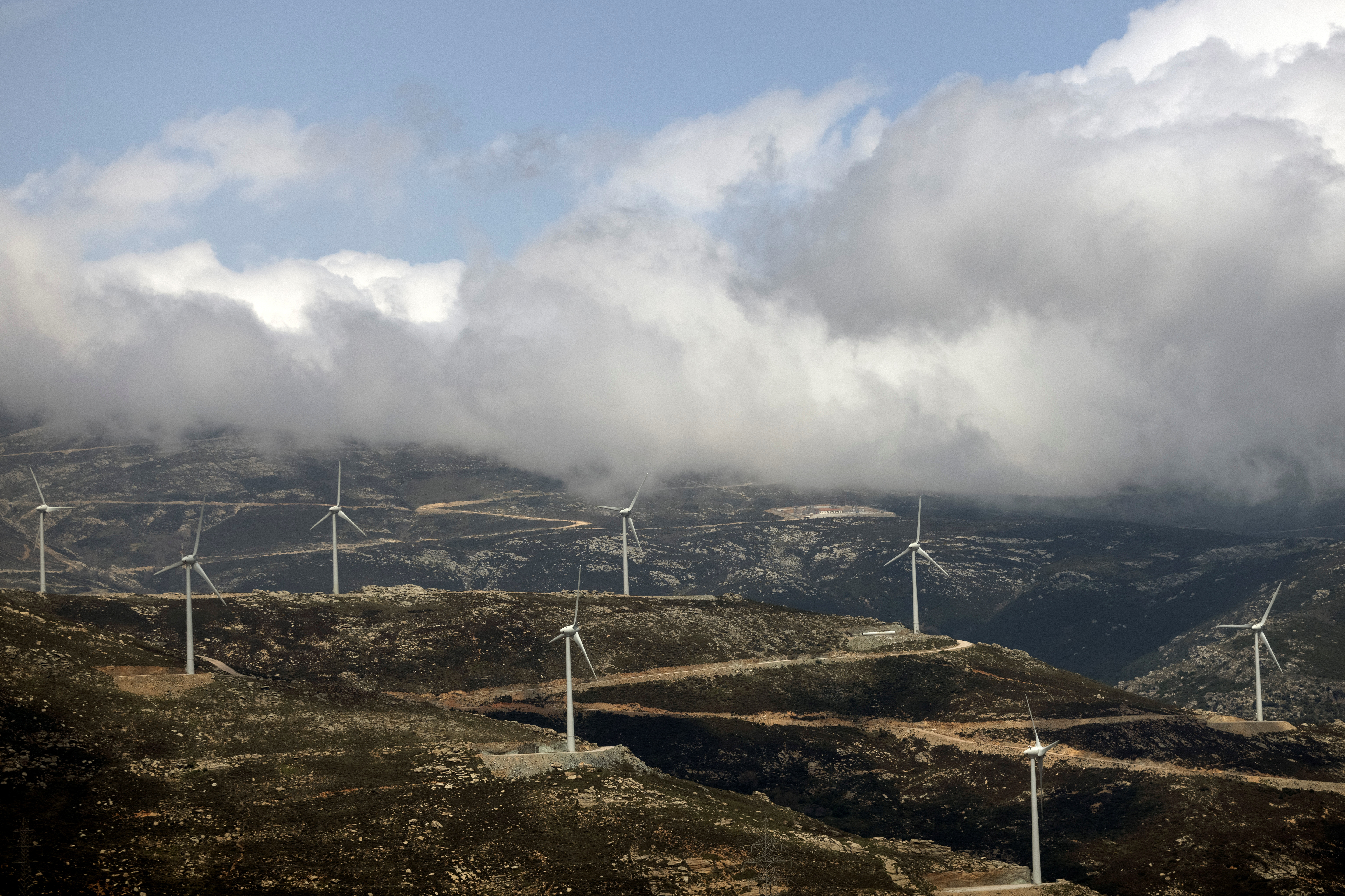Wind turbines are seen on a mountain near the town of Karystos, on the island of Evia, Greece, April 16, 2021. REUTERS/Alkis Konstantinidis