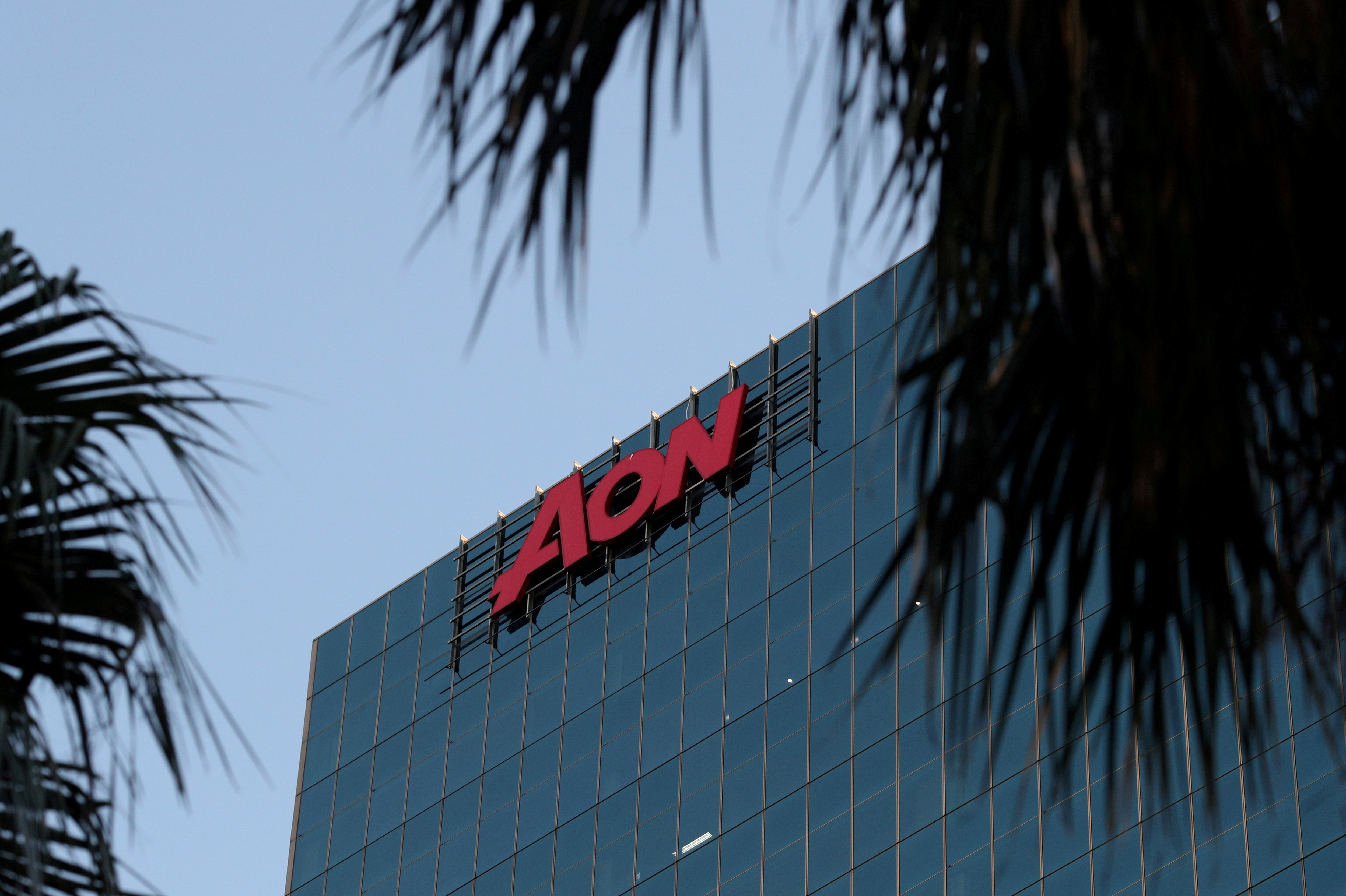 FILE PHOTO: An office building with the Aon logo is seen amid the easing of the coronavirus disease (COVID-19) restrictions in the Central Business District of Sydney, Australia, June 3, 2020. REUTERS/Loren Elliott