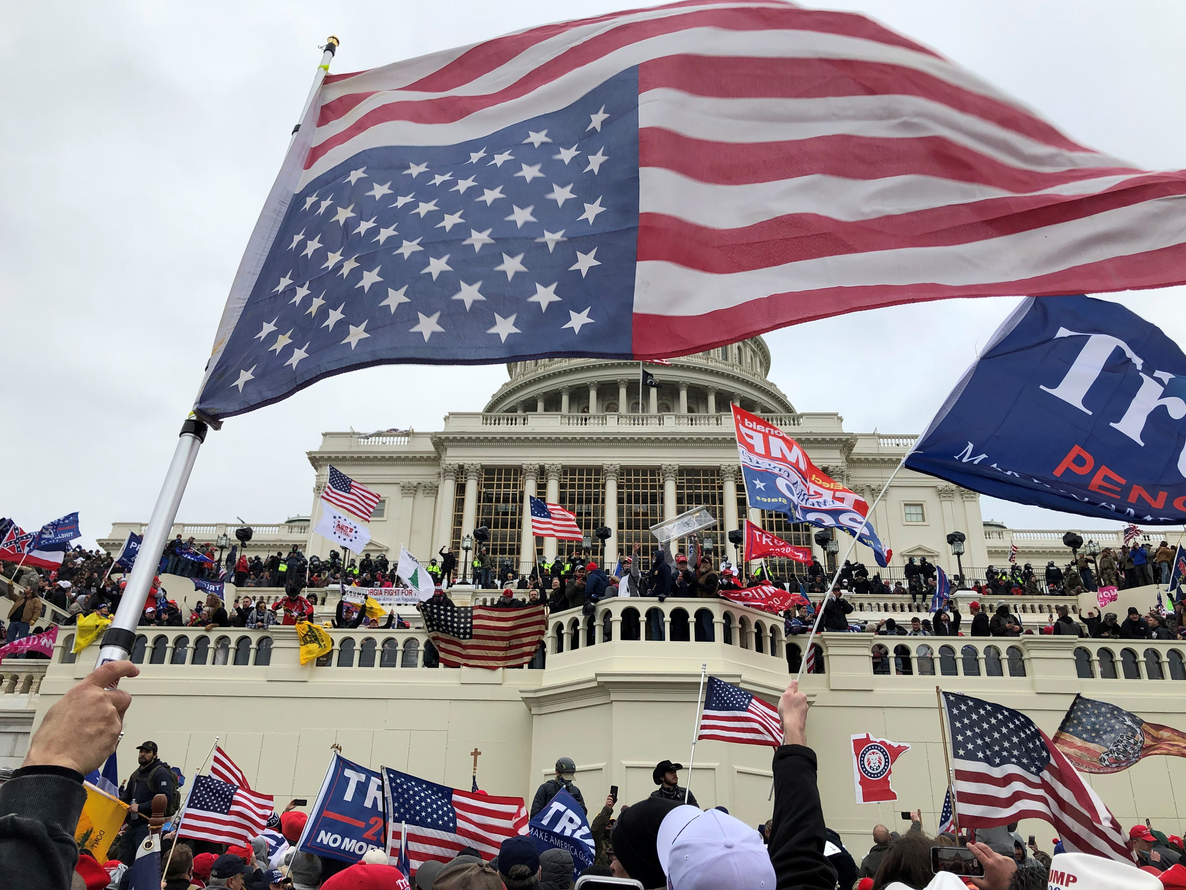 Supporters of U.S. President Donald Trump occupy the U.S. Capitol Building in Washington, U.S., January 6, 2021. Thomas P. Costello/USA TODAY via REUTERS