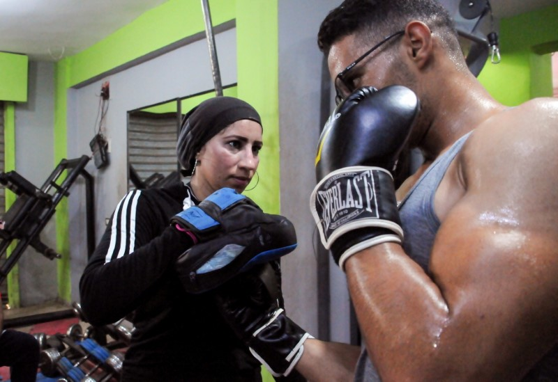 Sabah Saqr, an Egyptian boxing coach challenges social boundaries by training men, is seen during a training session at the gym, in Bani Swief, Egypt, June 11, 2021. Picture taken June 11, 2021. REUTERS/Rania Gomaa