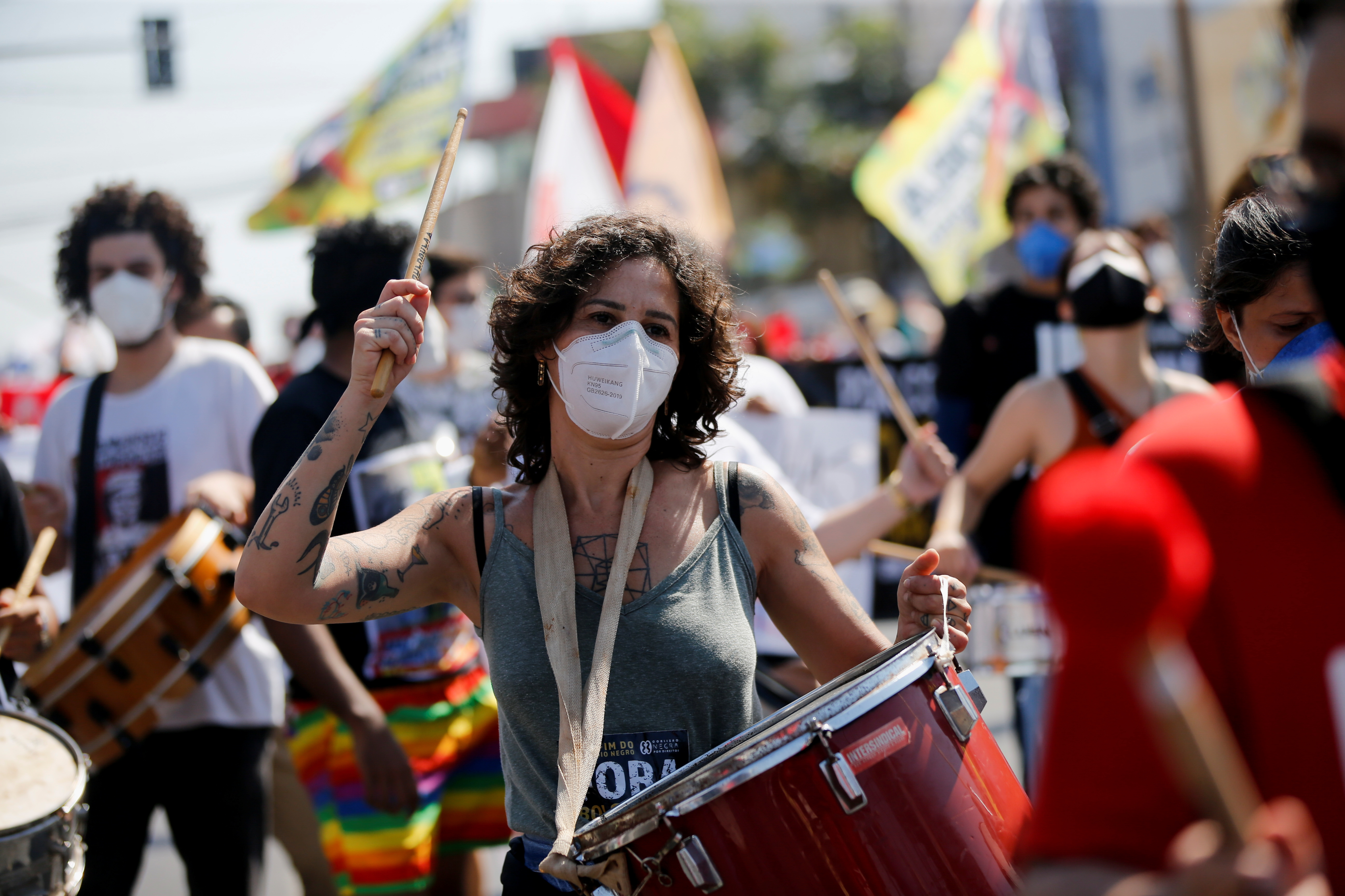 People participate in a protest against Brazil's President Jair Bolsonaro and his handling of the coronavirus disease (COVID-19) pandemic in Cuiaba, Brazil, June 19, 2021. REUTERS/Mariana Greif