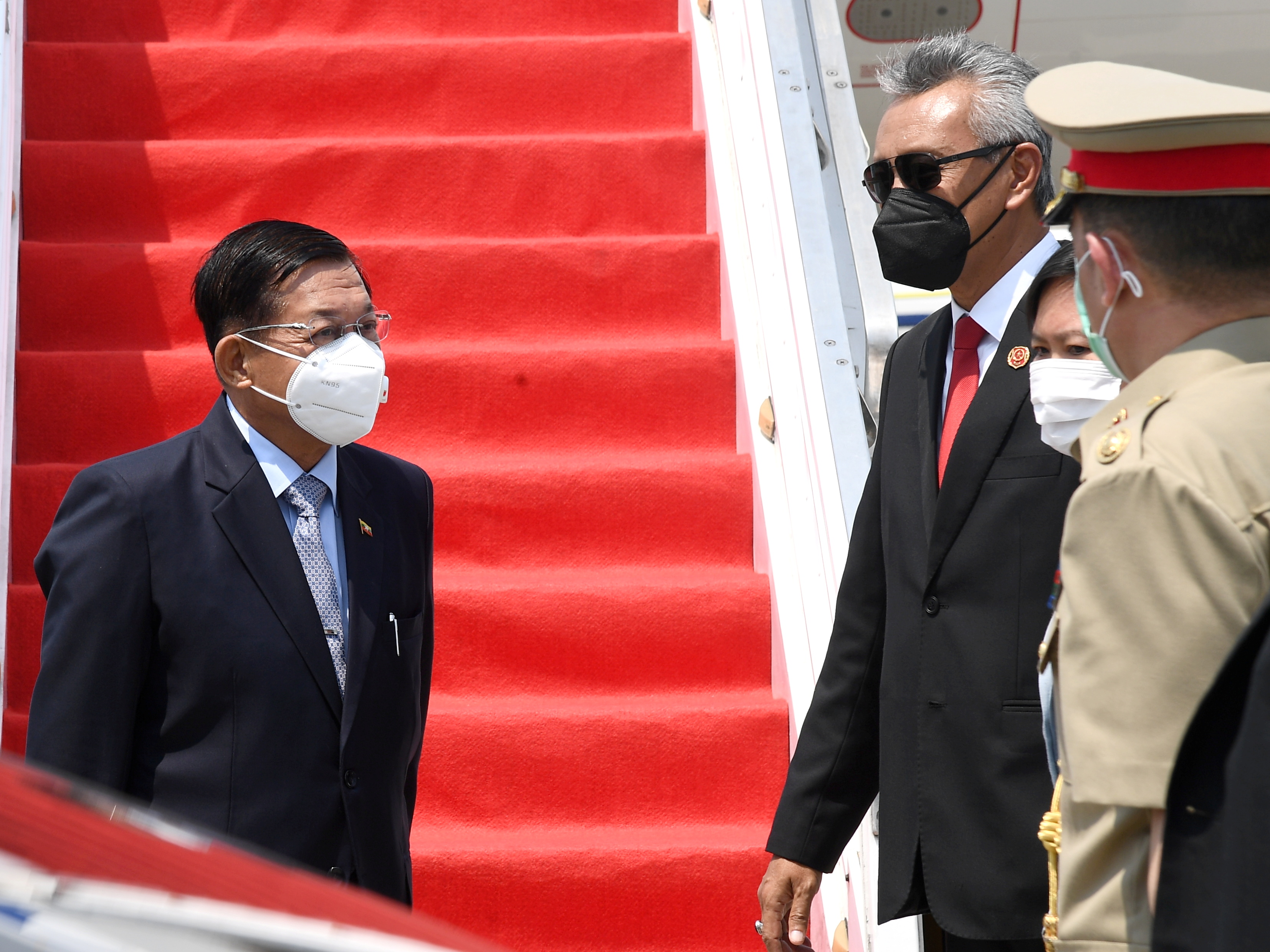 Myanmar's junta chief Senior General Min Aung Hlaing (L) is seen upon his arrival before the ASEAN leaders' summit, at the Soekarno Hatta International airport in Tangerang, on the outskirts of Jakarta, Indonesia, April 24, 2021. Courtesy of Rusman/Indonesian Presidential Palace/Handout via REUTERS