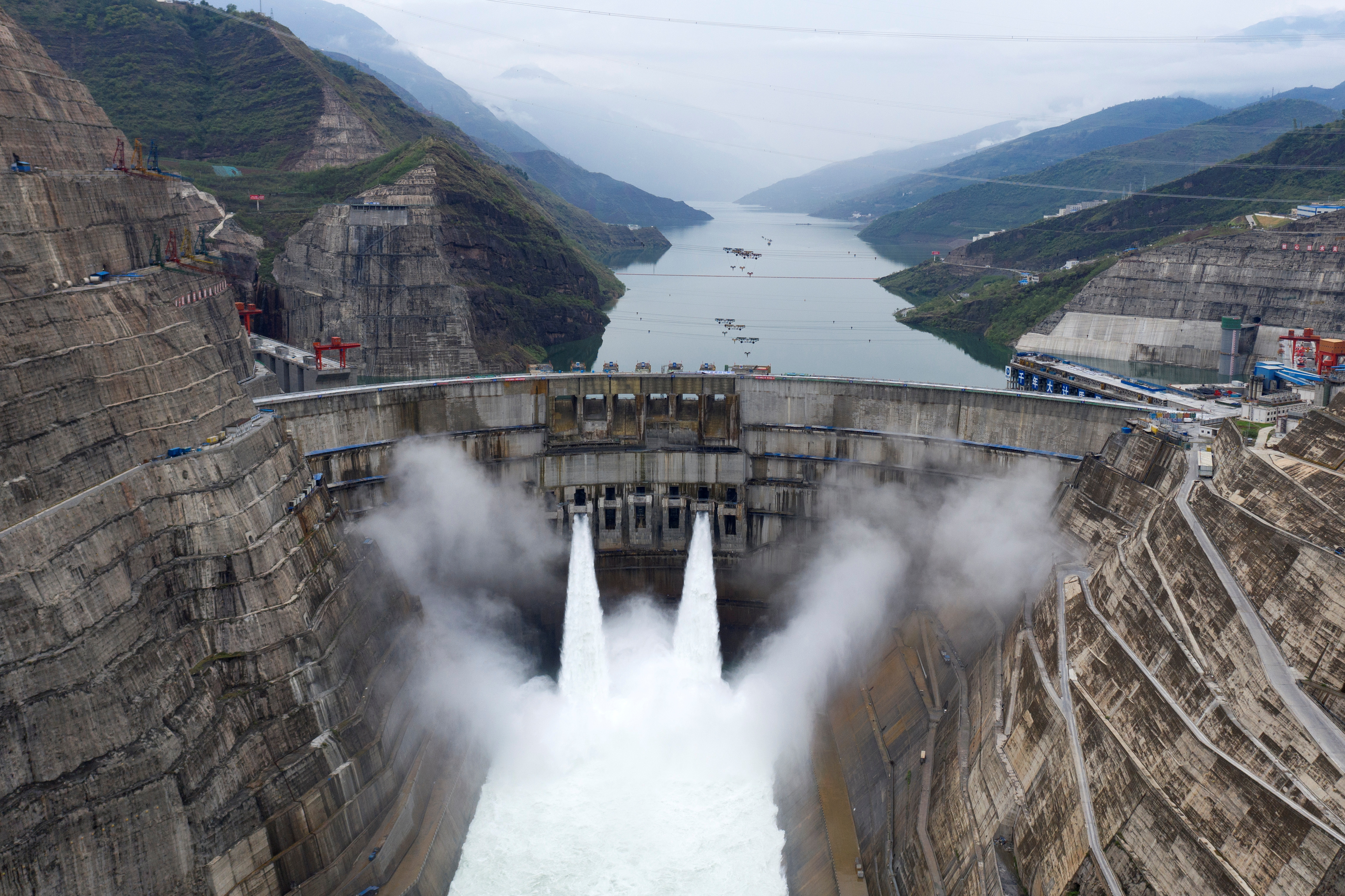The Baihetan hydropower plant is seen in operation on the border between Qiaojia county of Yunnan province and Ningnan county of Sichuan province, China June 28, 2021. Picture taken with a drone. cnsphoto via REUTERS