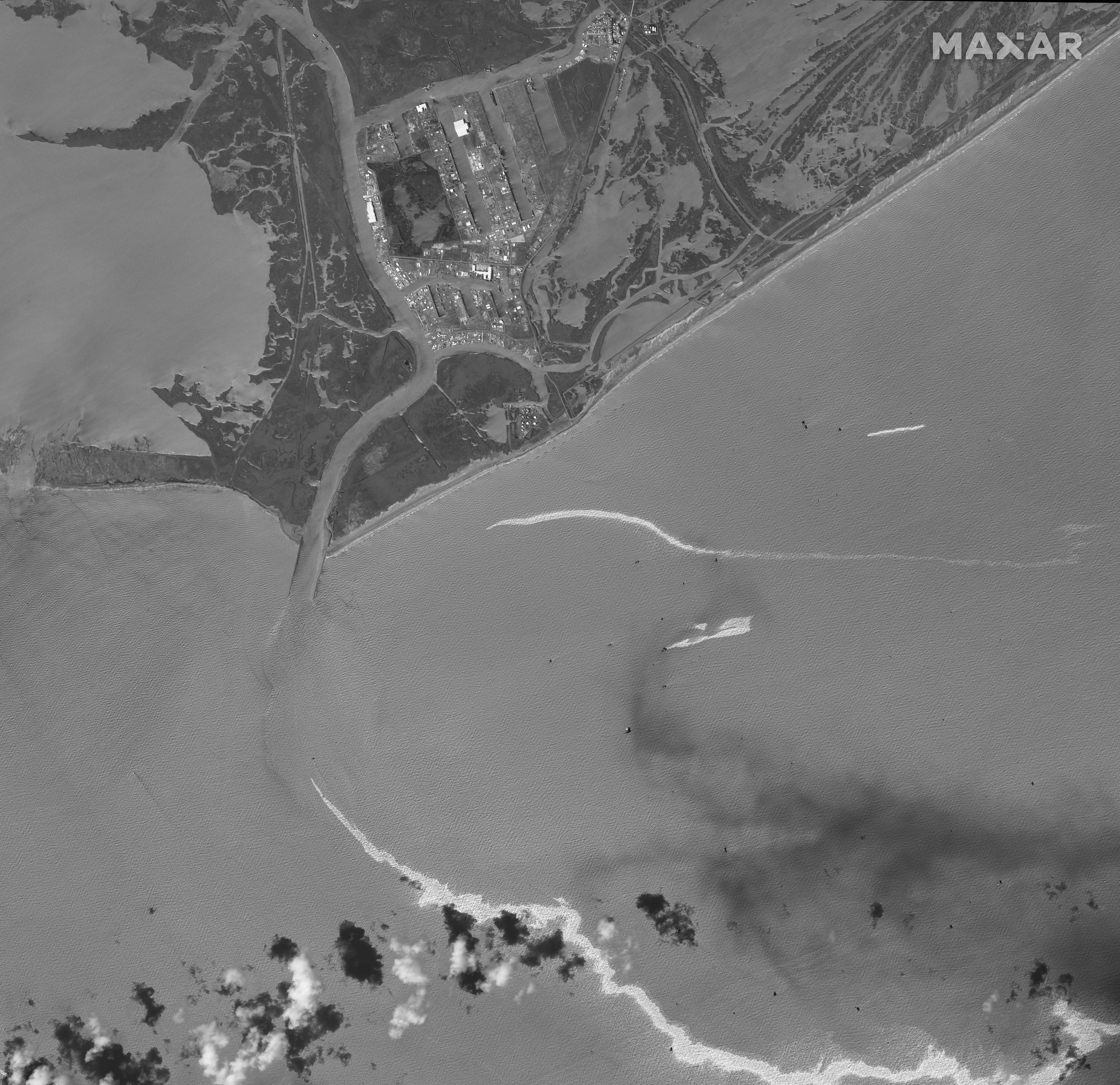 A black and white satellite image shows an overview of the port and an oil slick following Hurricane Ida, Port Fourchon, Louisiana, U.S., September 2, 2021. Satellite image 2021 Maxar Technologies/Handout via REUTERS
