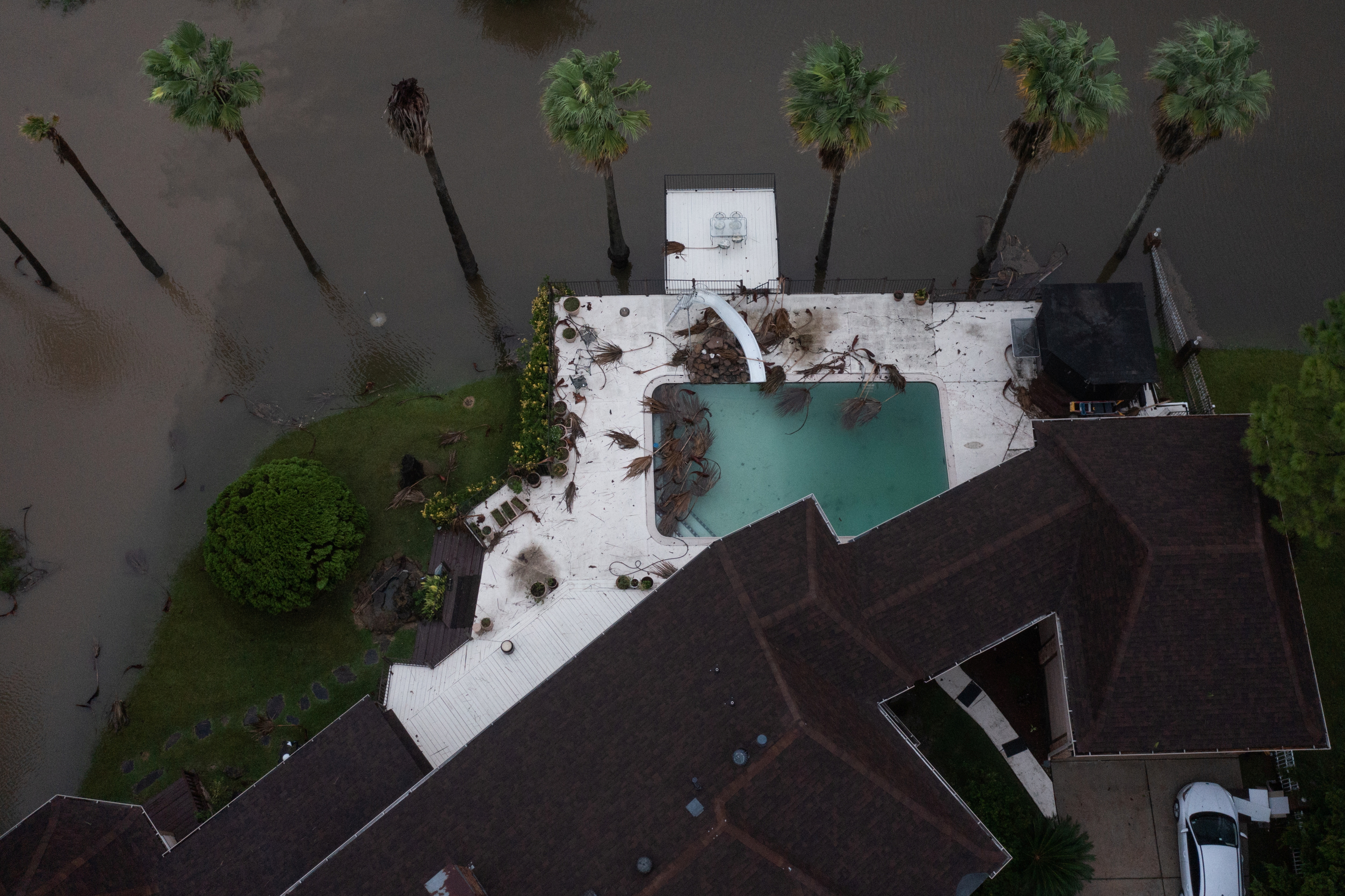 Debris lies in the pool of a home in the aftermath of Hurricane Nicholas in League City, Texas, U.S., September 14, 2021. REUTERS/Adrees Latif